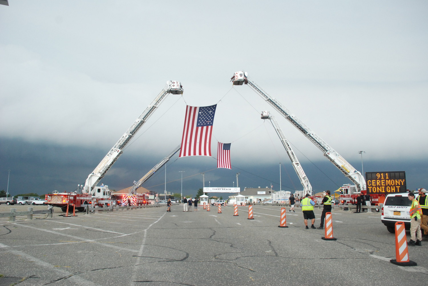 Local fire departments raised two huge flags over the Tobal Beach parking lot to welcome the relatives of those who died on Sept. 11, 2001.