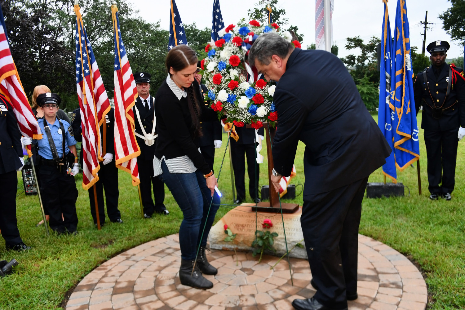Mayor Tim Tenke and Michelle Puckett-Formolo, daughter of one of the four 9/11 victims from Glen Cove, laid a wreath at the memorial.