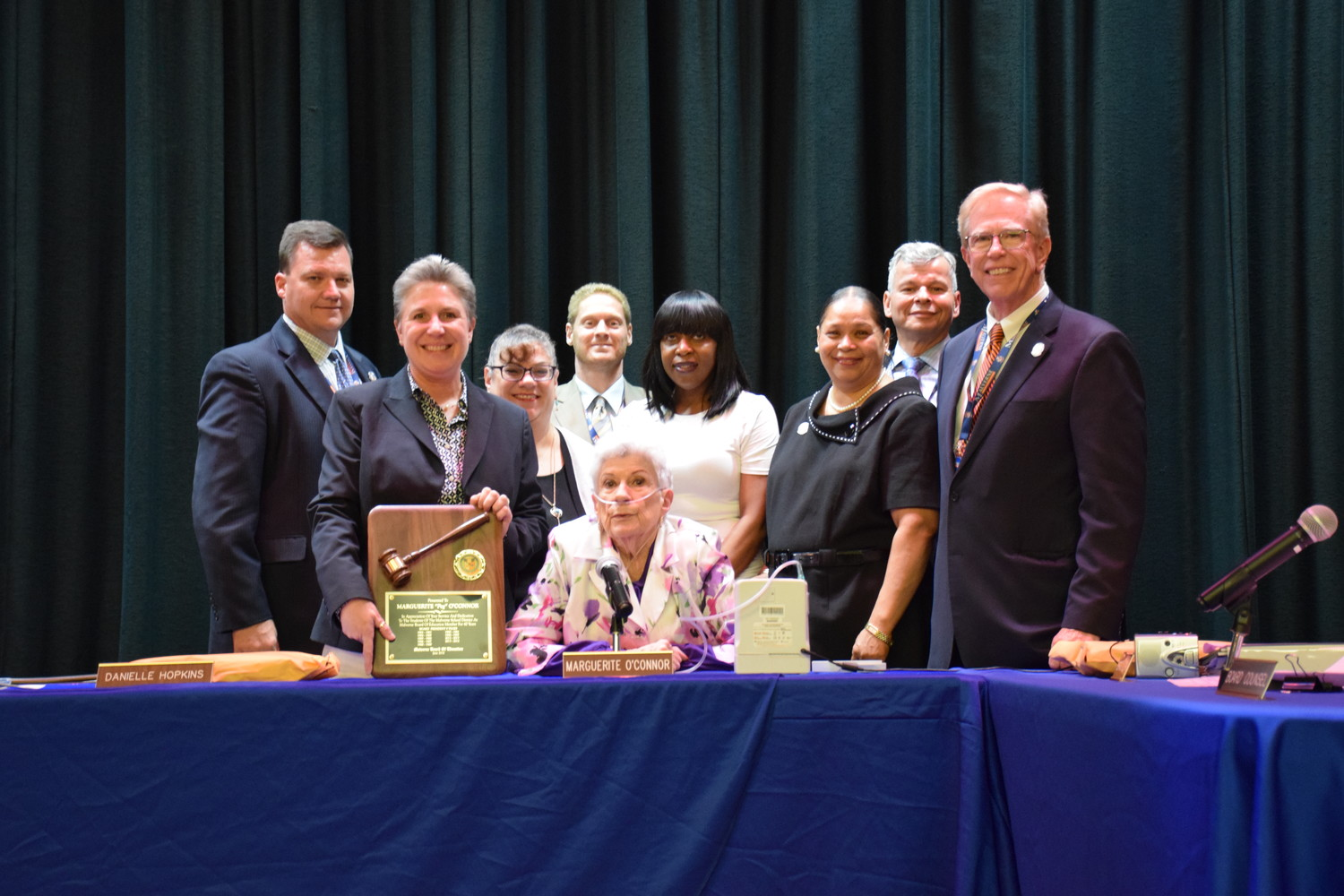 "Malverne Board of Education Trustee Marguerite ""Peg"" O'Connor, center, received a plaque from fellow board members and Superintendent Dr. James Hunderfund, far right, for her years of service."