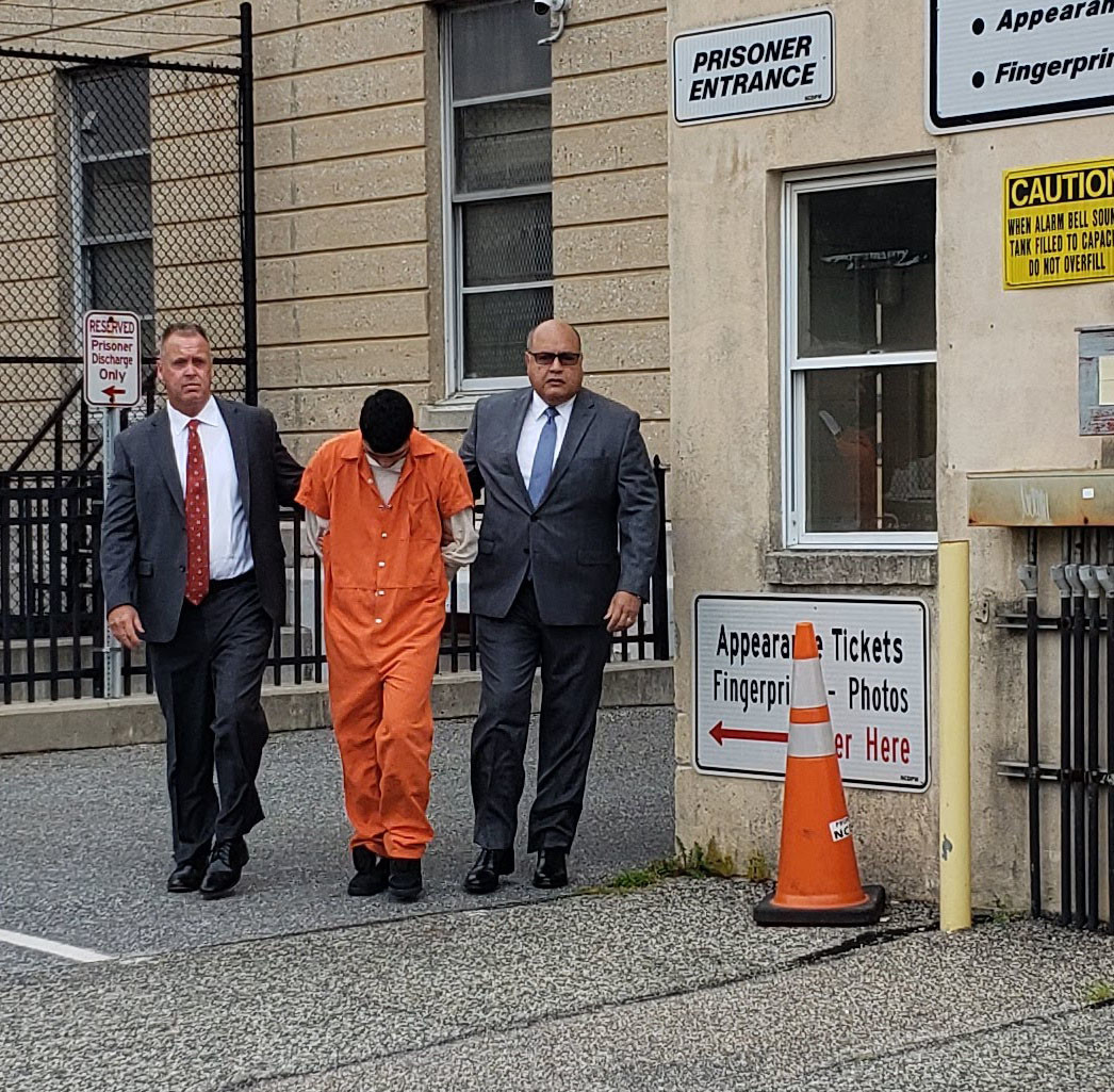 Kevin Lopez-Morales was escorted to his arraignment on Sept. 7 by Nassau County detectives.