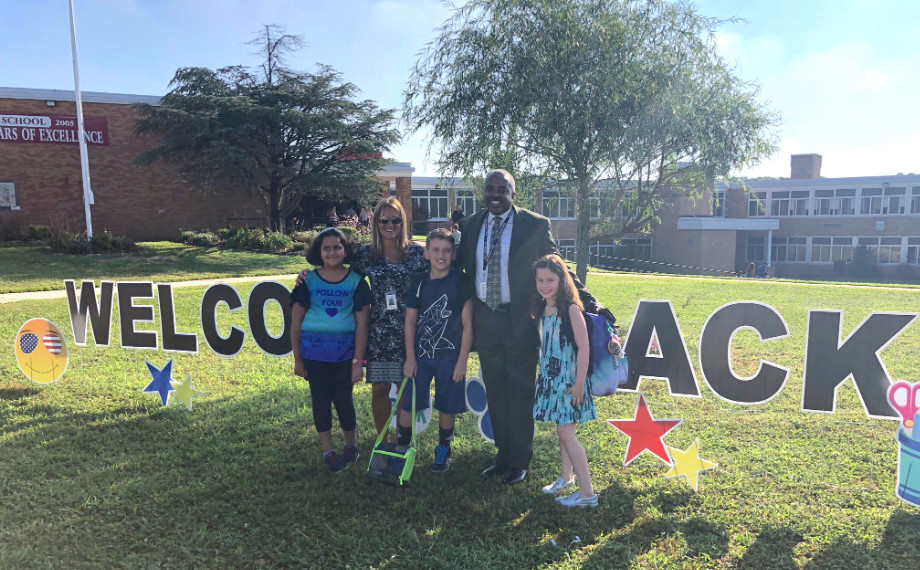 East Meadow Superintendent Dr. Kenneth Card Jr., center, and Assistant Superintendent for Personnel Anthony Russo, right, joined the fifth-grade safety patrol at Meadowbrook Elementary School during dismissal on Sept. 5.