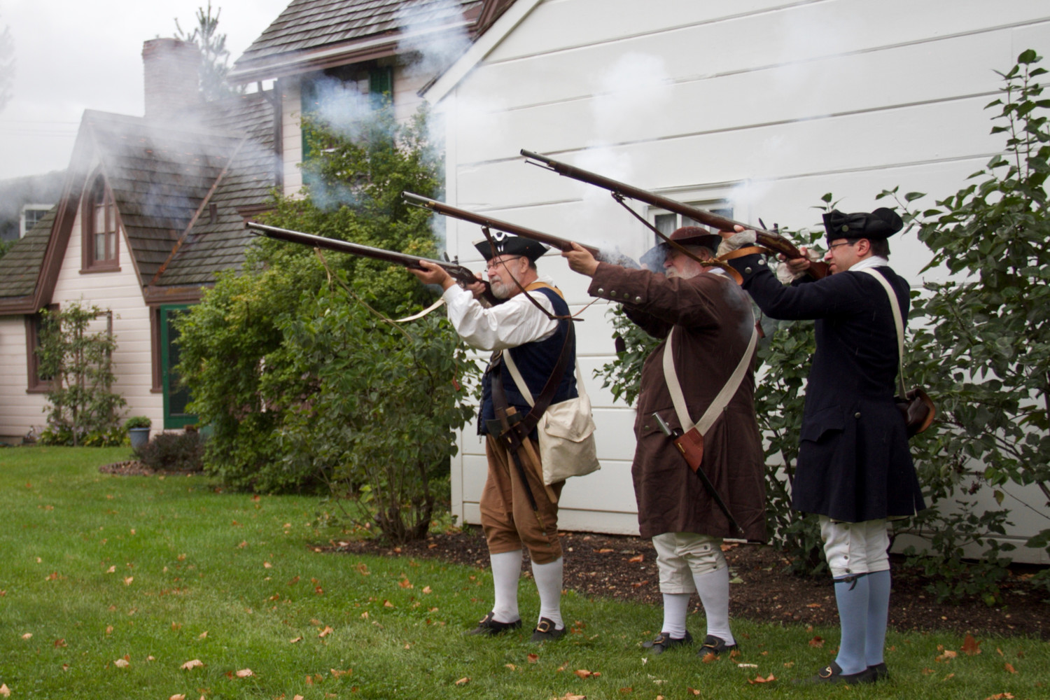 Members of the Huntington Militia, from left, Andy Tauvers, Jim Kerrigan and Patrick Mantle, fired their muskets.