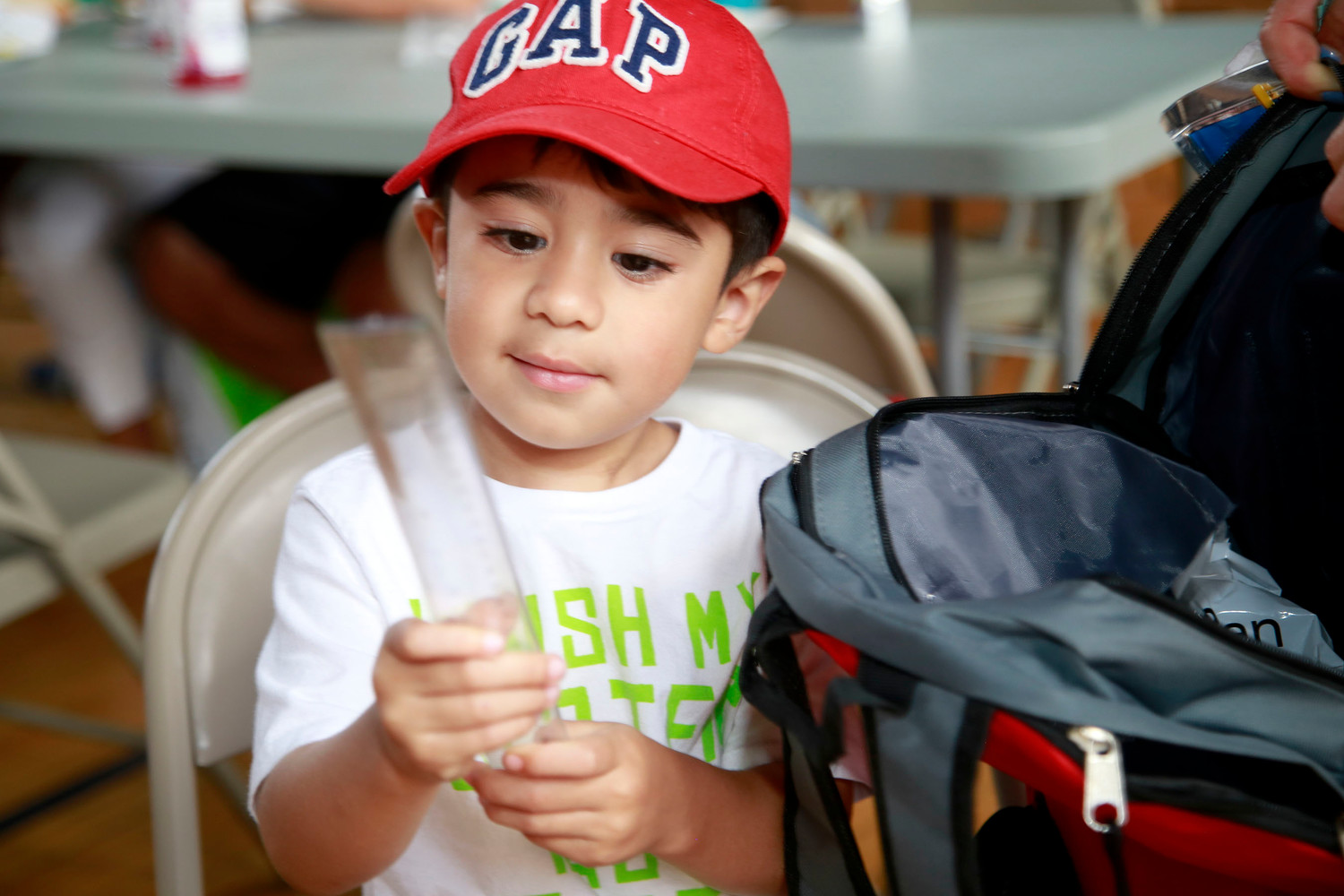 Jacob Martinez, 3, checked out the goodies in his new backpack.