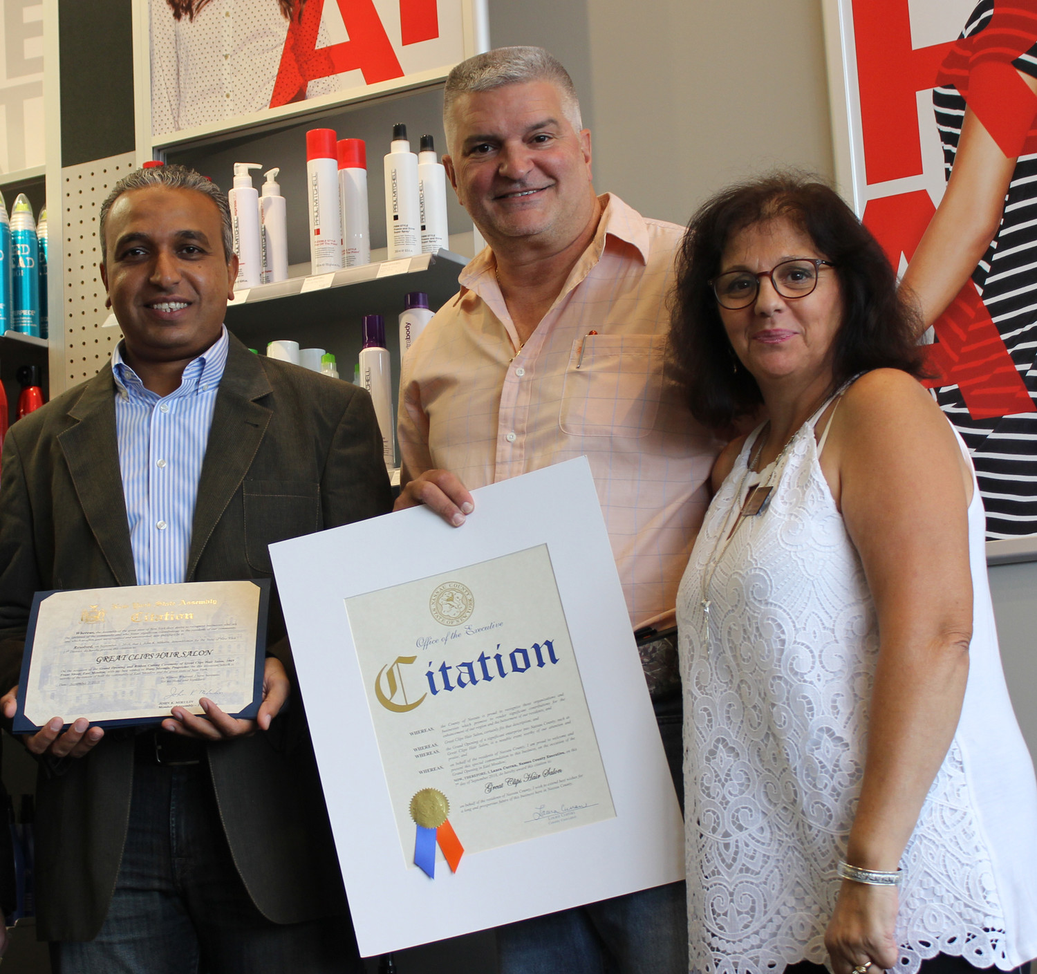 Hany Mostafa, left, thanked Frank Camarano, the president of the Chamber of Commerce, and Christine Mooney, the Chambers vice president, for welcoming his business to the community.