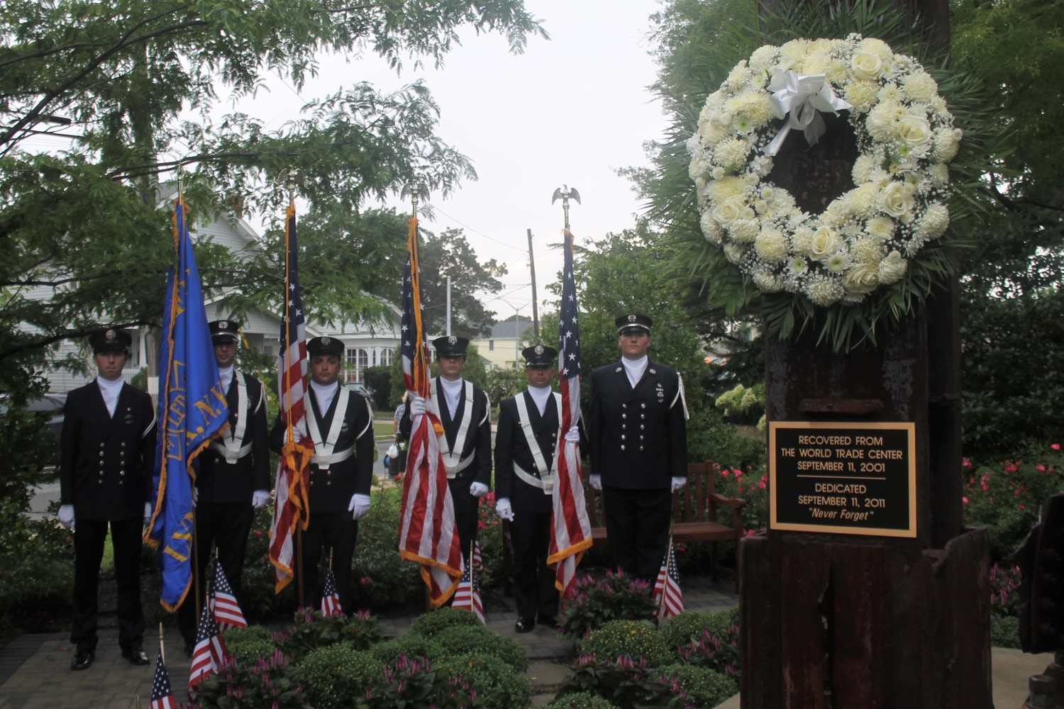 Lynbrook held its 9/11 memorial ceremony outside Village Hall on Tuesday. Members of the Lynbrook Fire Department's color guard stood next to a piece of steel recovered from the World Trade Center after the terrorist attacks of Sept. 11, 2001.