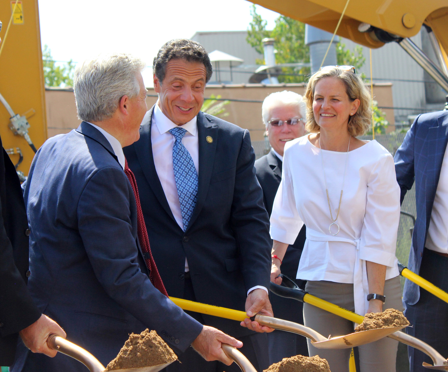 In honor of the official groundbreaking of the LIRR's third track, Gov. Andrew Cuomo, center; Nassau County Executive Laura Curran, right; and Suffolk County Executive Steve Bellone dug shovels into a construction site at the Westbury LIRR station.