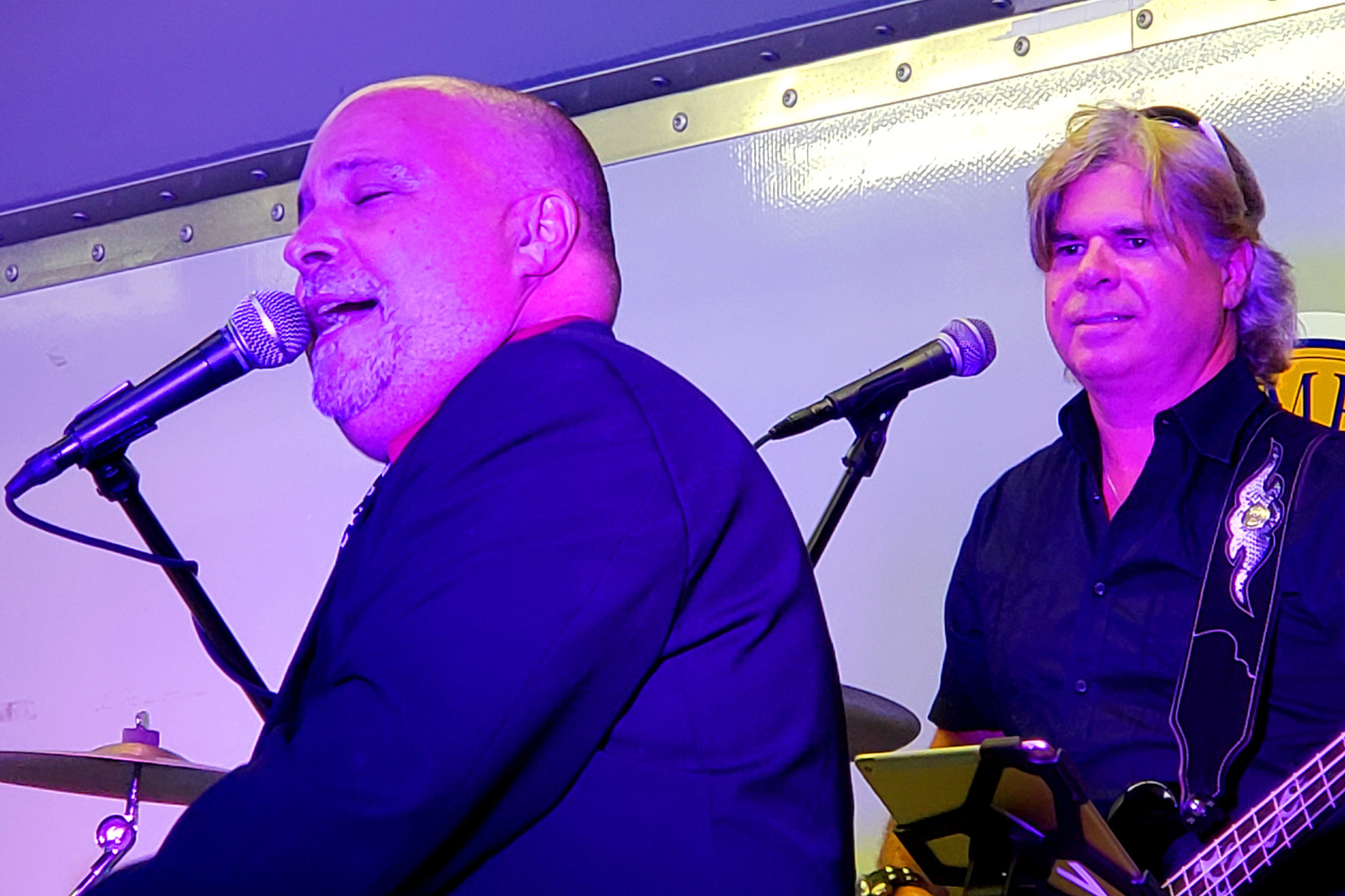 The Cold Spring Harbor Band, which includes vocalist Pat Farrell, left, and bass guitarist Kevin Hawkins, covered many of Billy Joel's hits to close out Malverne's annual Summer Entertainment Series at Westwood Park on Aug. 30.