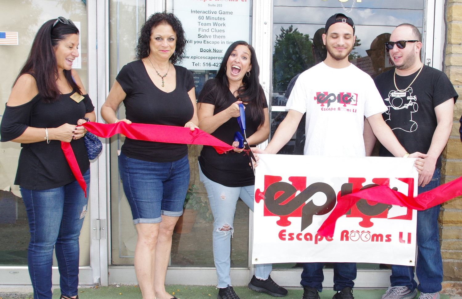 West Hempstead Chamber of Commerce members Vita Zorbo, left, and Terese Russo-Santoro, joined Epic Escape Rooms L.I. co-owner Cathy Dunn, her son, Mike, and her brother, co-owner Efren Santana, for a ribbon-cutting ceremony on Sept. 15.