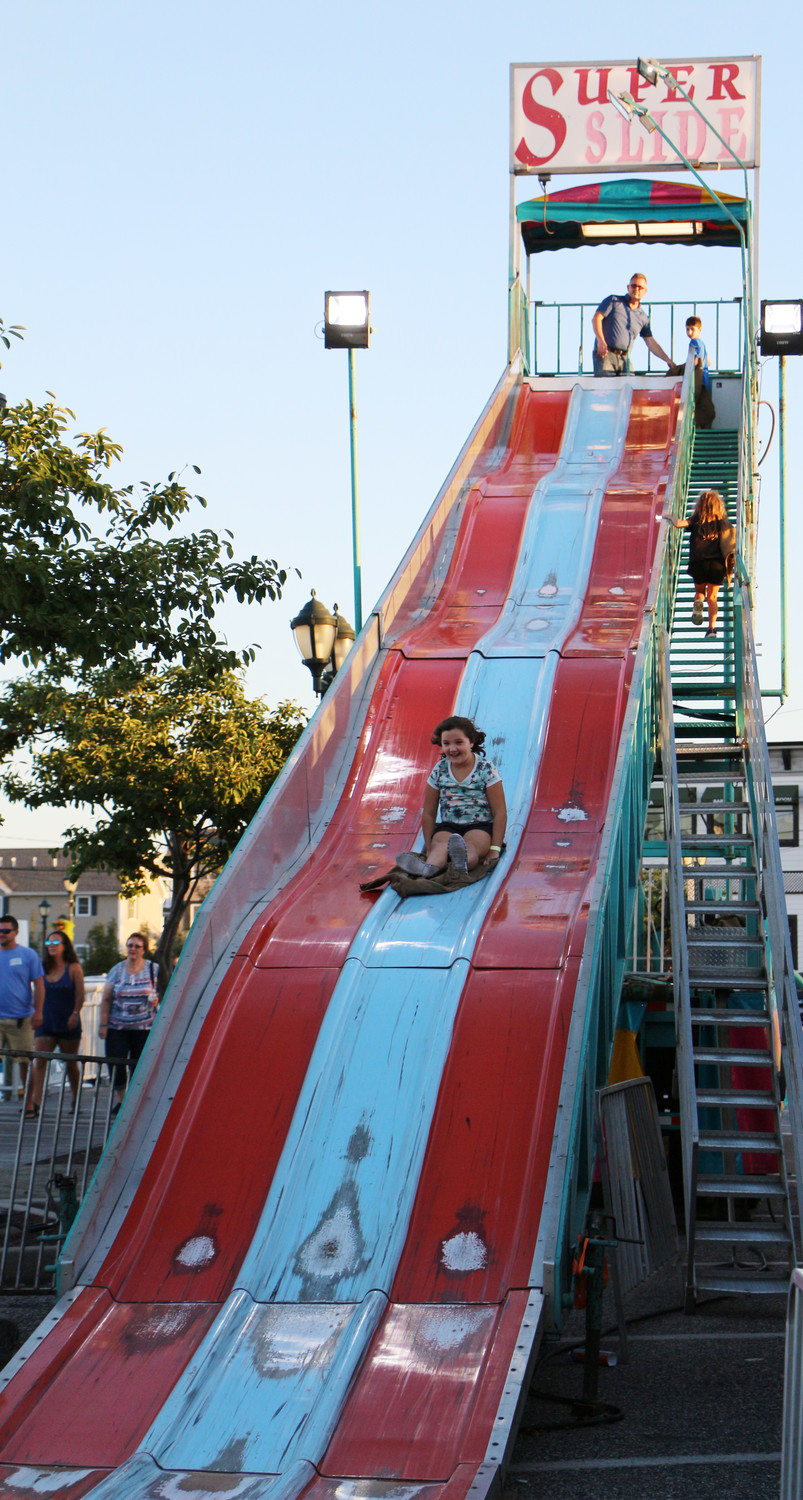 Molly Brown, 7, slid down the super slide, which was one of many rides at the event.