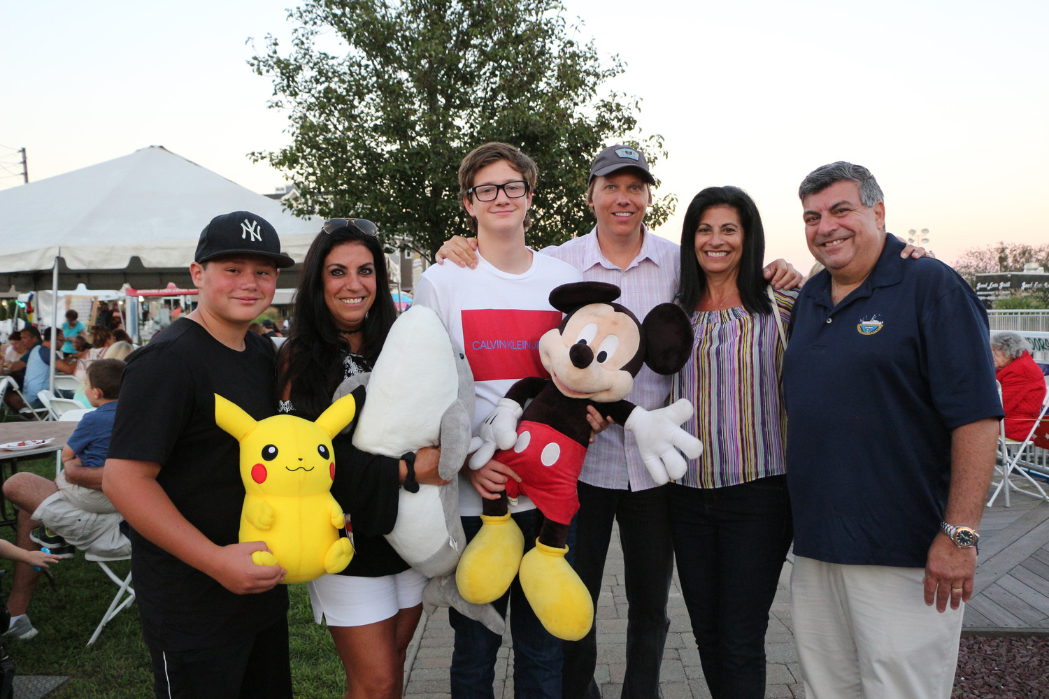 East Rockaway Mayor Bruno Romano, far right, spent time with some members of his family at the Stars & Stripes Festival. From left, Joseph Romano, Lida Gelopter, Cameron Catanzaro and Earnie and Angela Catanzaro.