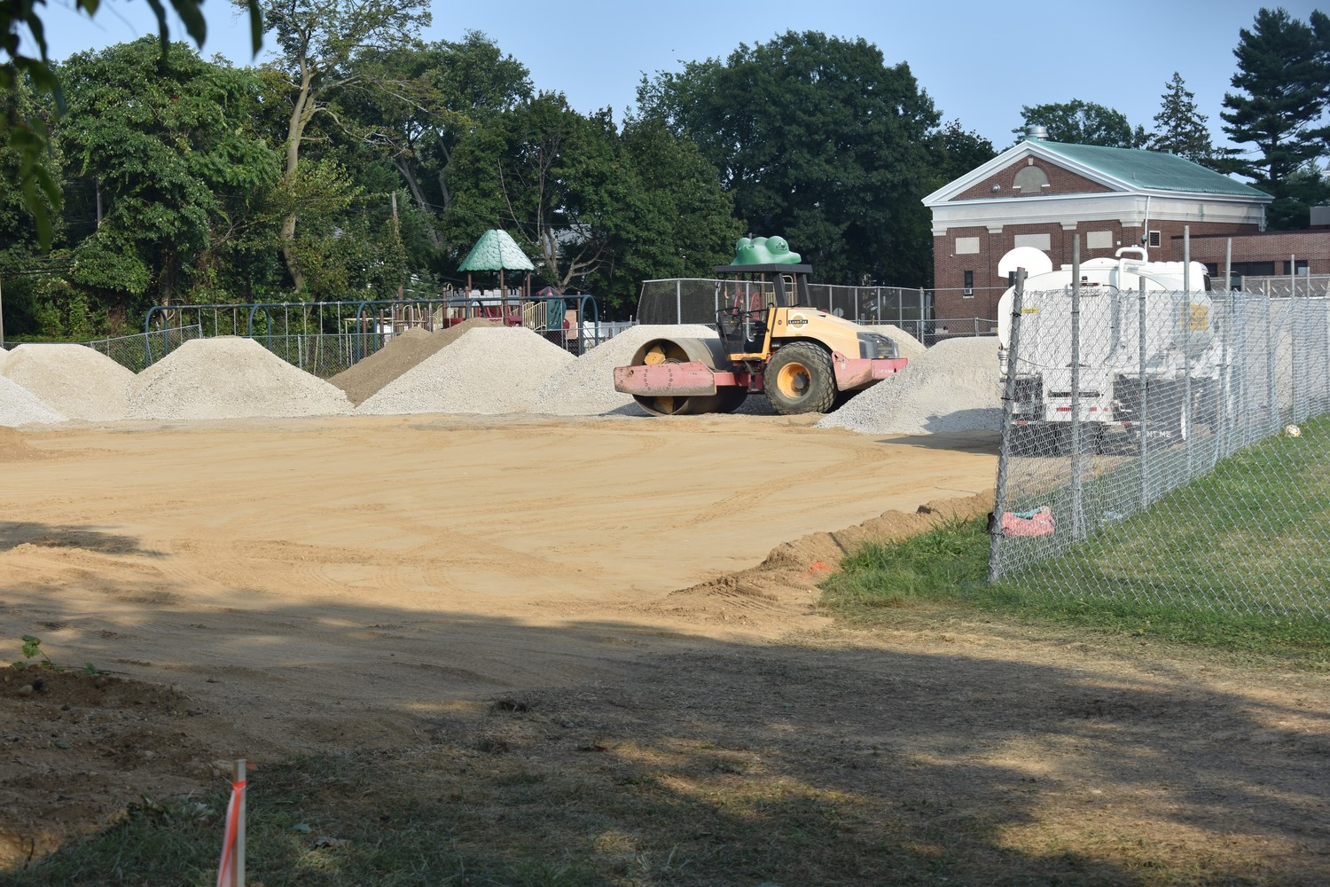The tennis courts at Jennie E. Hewitt Elementary School are currently being replaced.