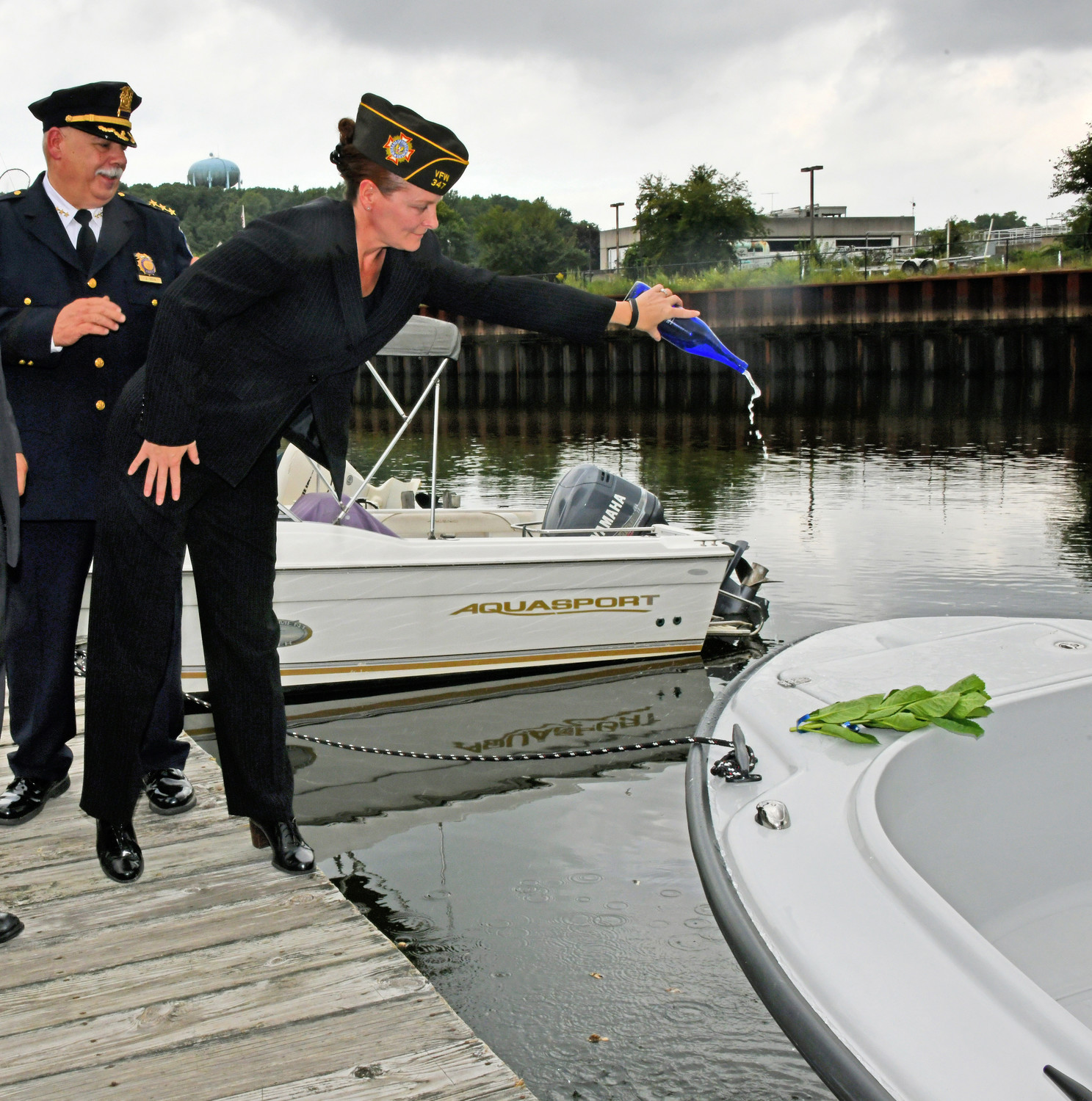 Christina Noon, christened the new Harbor Patrol vessel, named in honor of her father, World War II veteran and POW Private First Class Louis J. Noon.