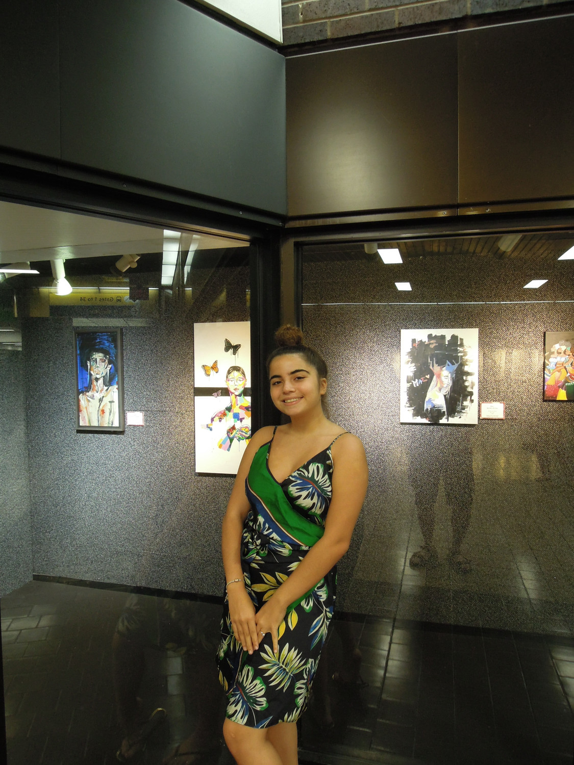 Valley Stream senior Juliana Hernandez at her exhibition at the Port Authority Bus Terminal. It runs through Sept. 29.