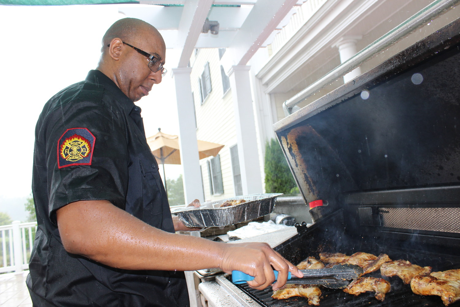 Despite the pounding rain, Chef John William, of the Roslyn Fire Department, grilled his best ribs.