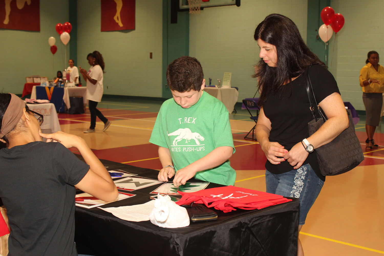 Freeport Health Fair 9/15/18 Jeannette Acquavella and her son Matthew, age 10, visit one of the tables at the Freeport Recreation Center health fair held for residents on Saturday, September 15th.