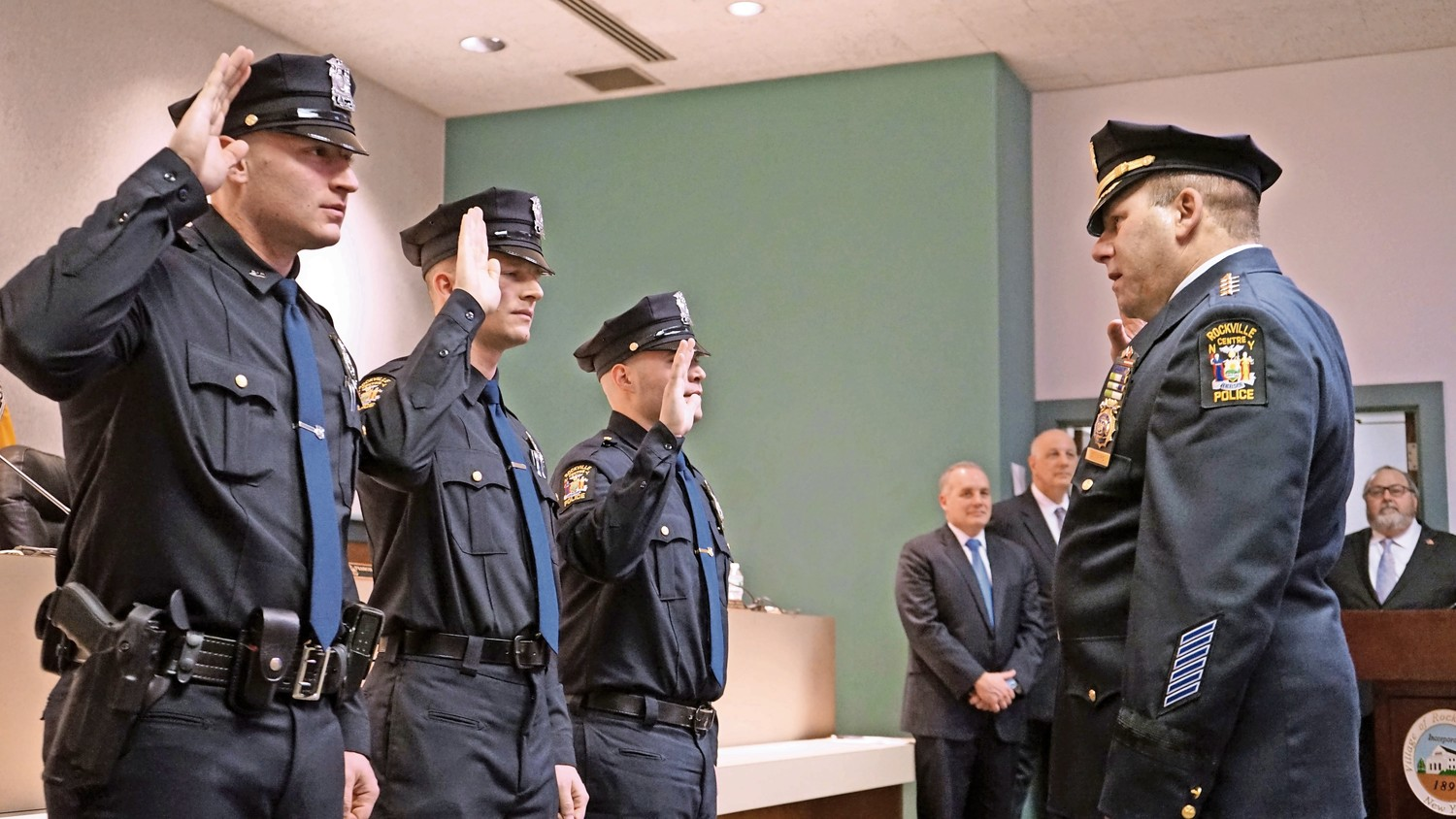 A Nassau County judge dismissed a charge against Rockville Centre Police Officer Christopher Stafford, left, who was arrested and charged with second-degree unlawful surveillance on Feb. 10. Above, he was sworn in on March 6, 2017.