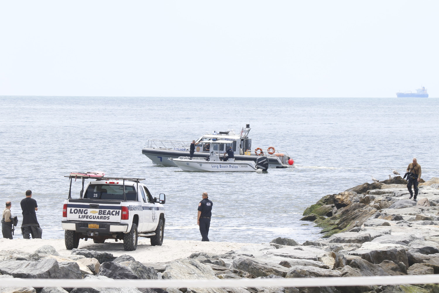 Long Beach authorities, shown during a search for a missing swimmer on June 20, pulled an unresponsive man from the water at Tennessee Avenue beach on Friday.