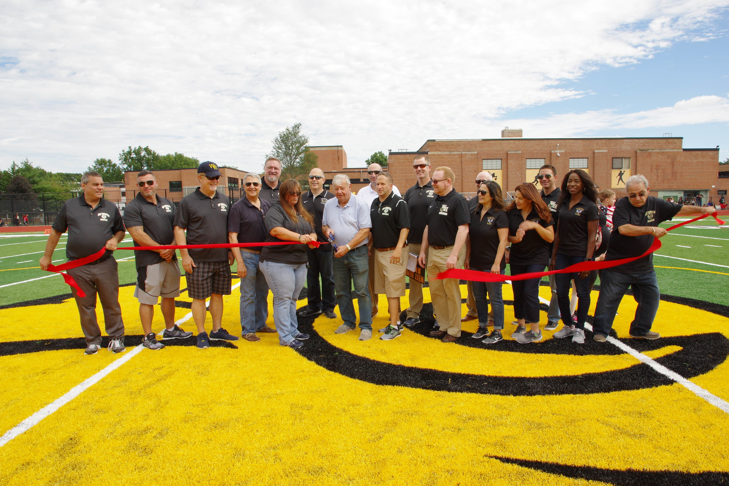 West Hempstead School District's Board of Ed did the honors of cutting the ribbon for the high school's newly installed artificial turf field during their Homecoming ceremony on Sept. 22.