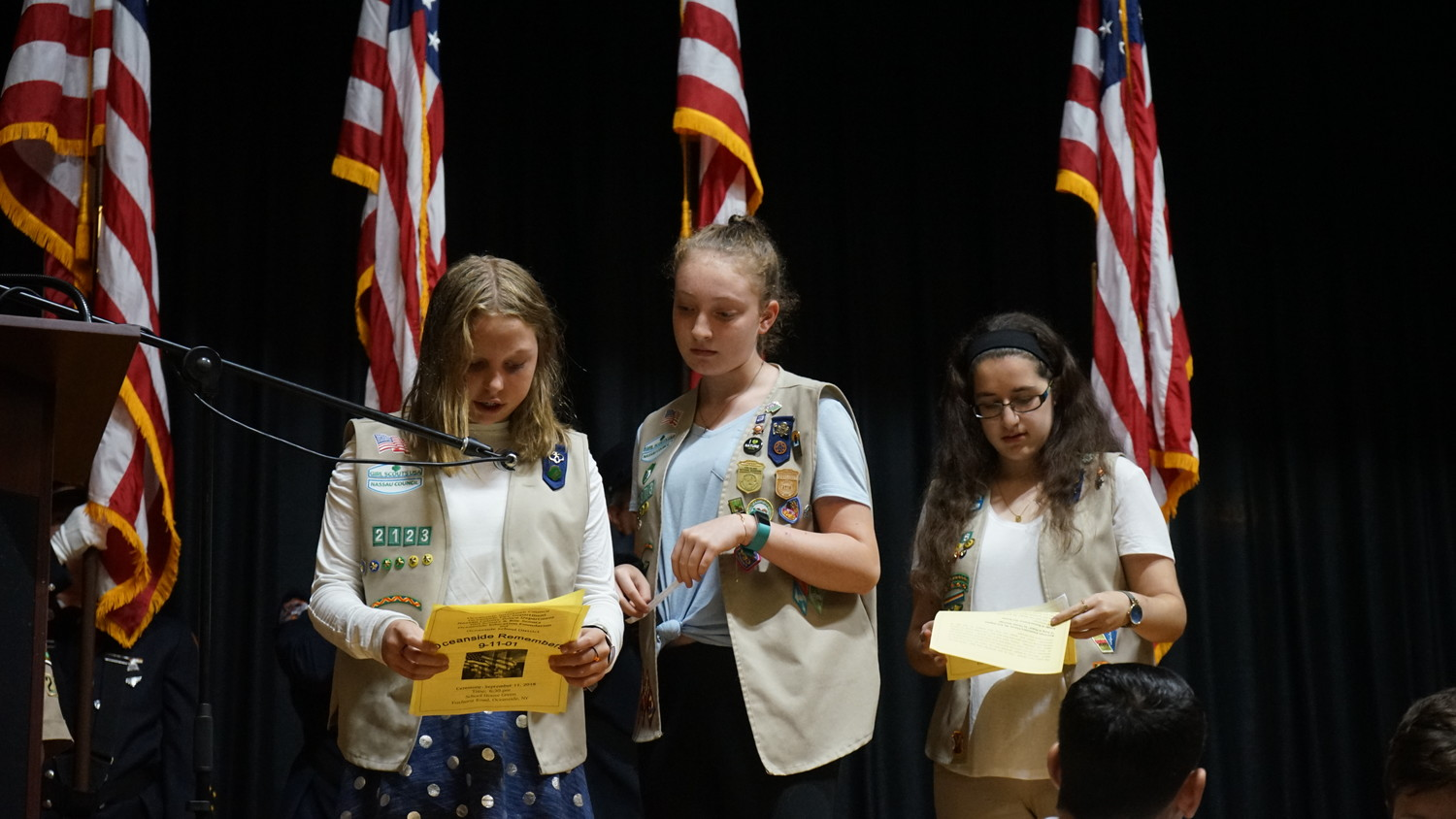 Oceanside Girl Scouts Reese Allegra, left, Nicole Greene and Alison Abbey read prayers for the fallen.