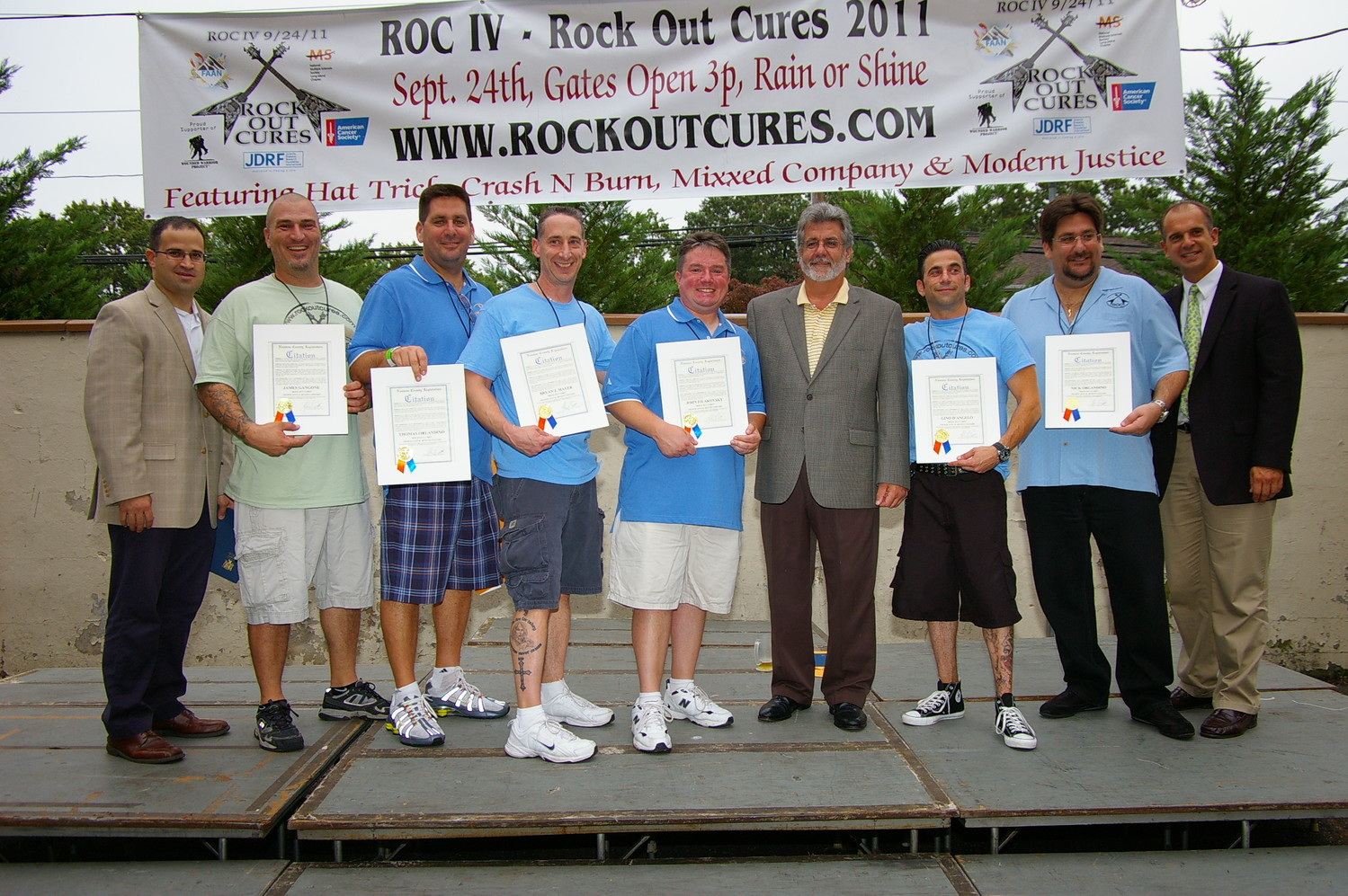 During the fourth concert, local officials, including former Nassau County Legislator John Ciotti, third from right, above, recognized ROC board members for their charity work, including, from left, James Gangone, Thomas Orlandino, Bryan Mayer, John Filakovsky, John Ciotti, Gino D'Angelo and Nick Orlandino.