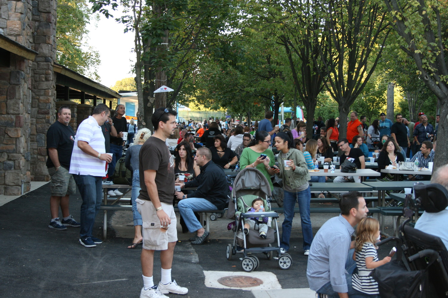 Thousands of residents of Franklin Square and nearby communities, left, gather at Plattdeutsche Park's garden for the annual concerts.