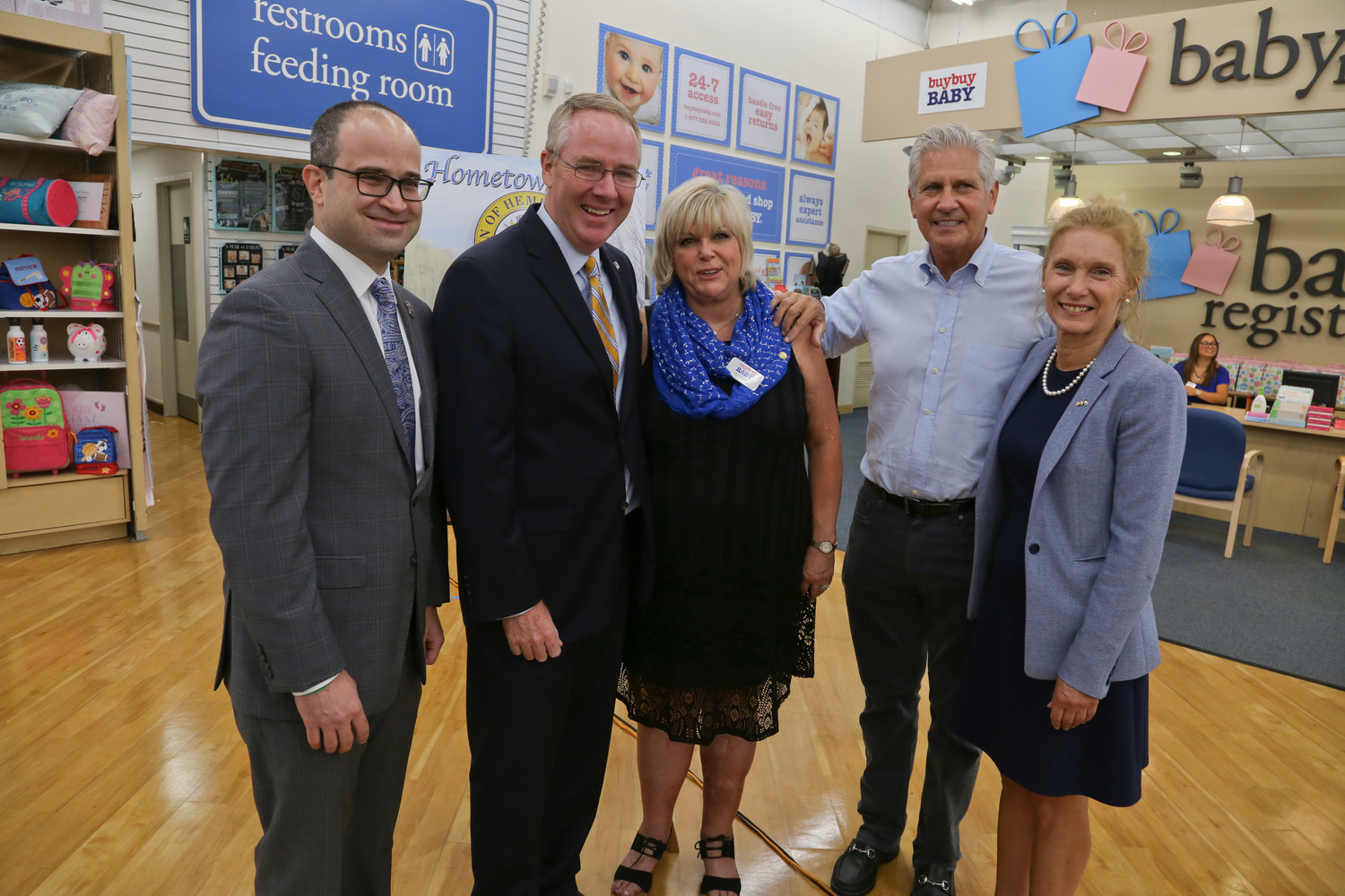 Kathy Falco, center, flanked by Assemblyman Ed Ra, from left, Town of Hempstead Receiver of Taxes Don Clavin, Town Councilor Bruce Blakeman and State Sen. Elaine Phillips.