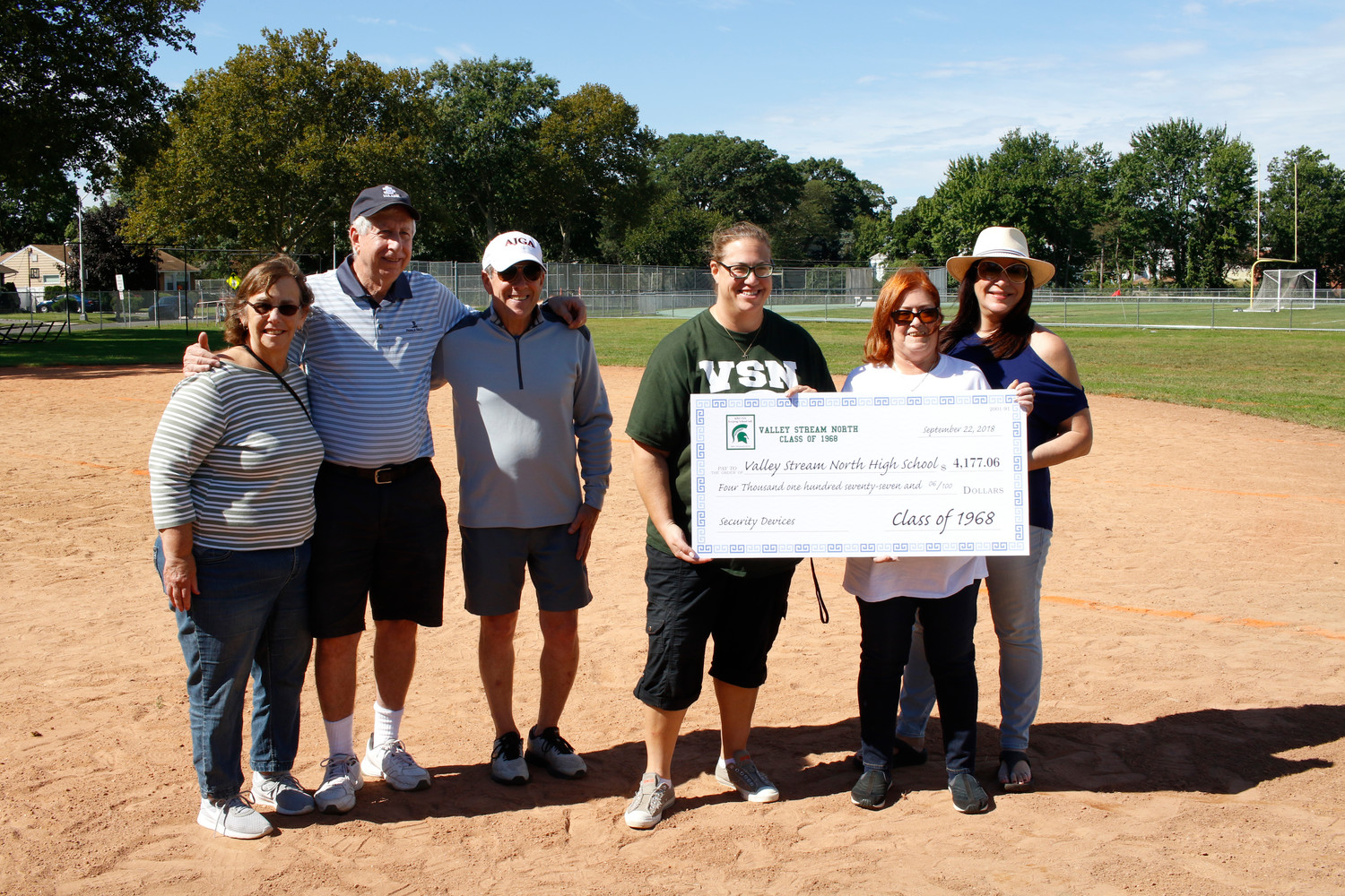 Myra Hilfer, Rich Bentley, Larry Bloom, Sheila Borgese and Sharon Mirsky-Levine presented Principal Rachel Green, center, with a check for $4117.06 that would fund security upgrades to the school.