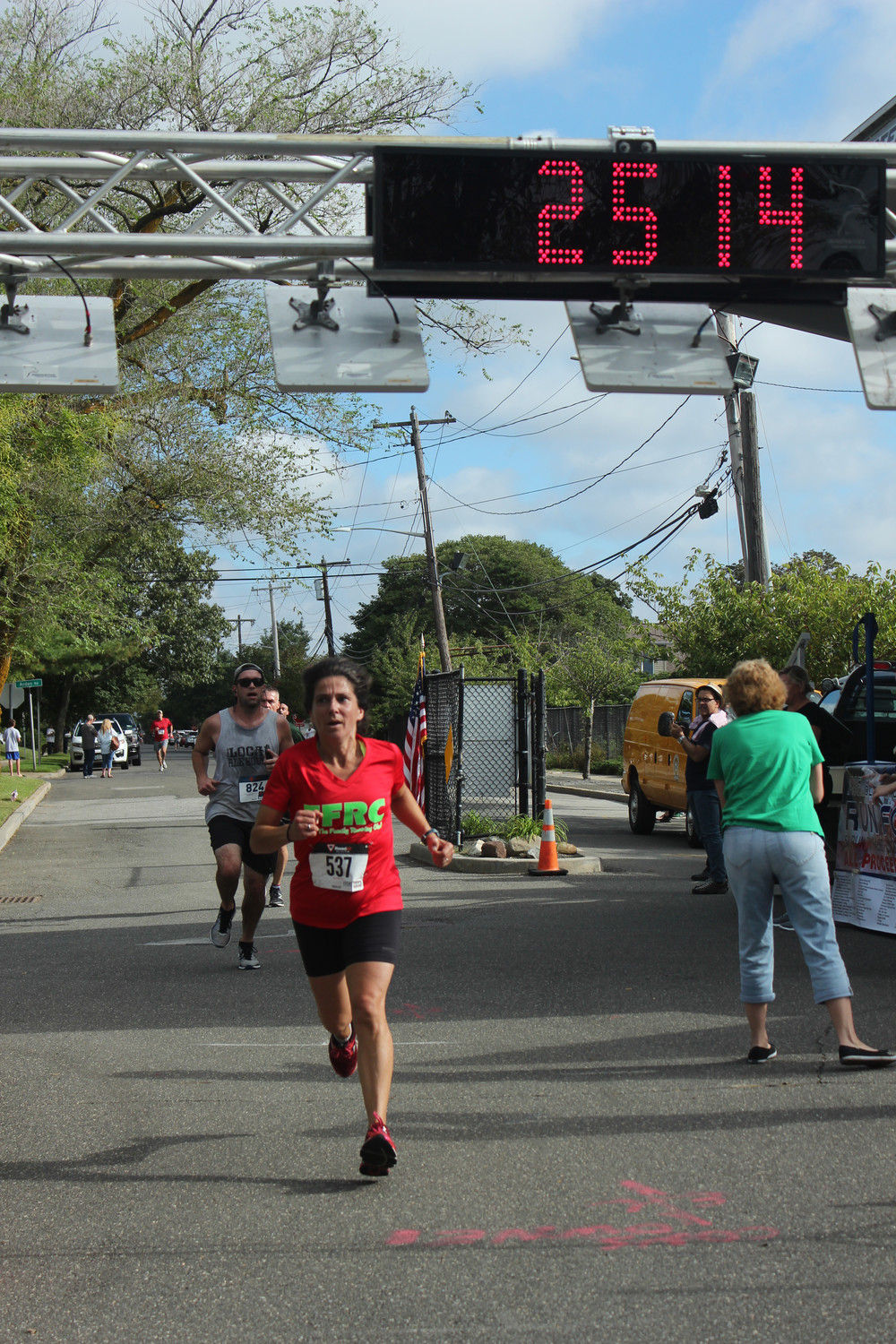 Lynbrook resident Jayne Paskoff paced all women with a time of 25 minutes, 14 seconds.