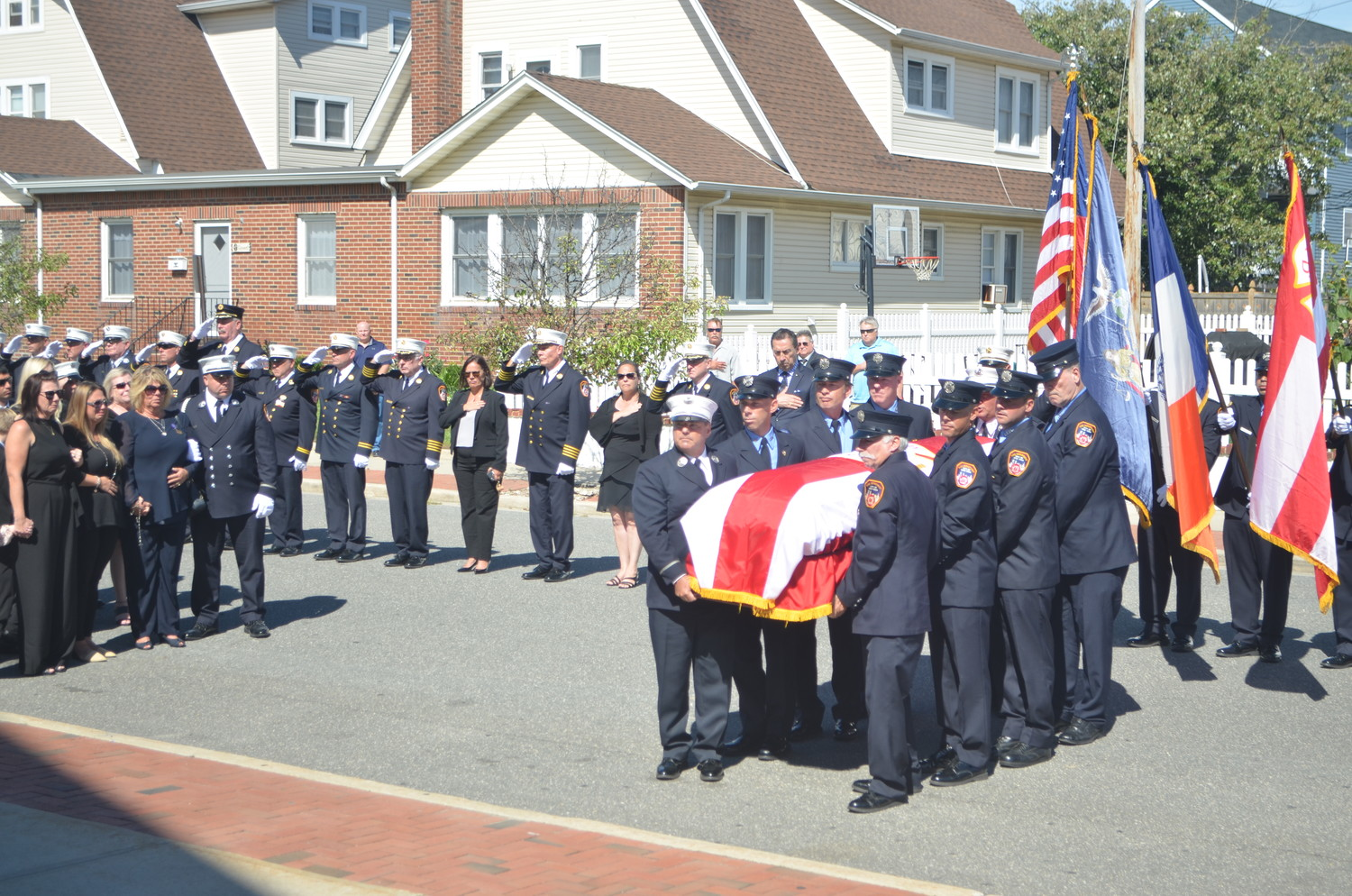 Members of the New York City Fire Department carried Elges's casket to his funeral service at St. Ignatius Martyr Church last Saturday.