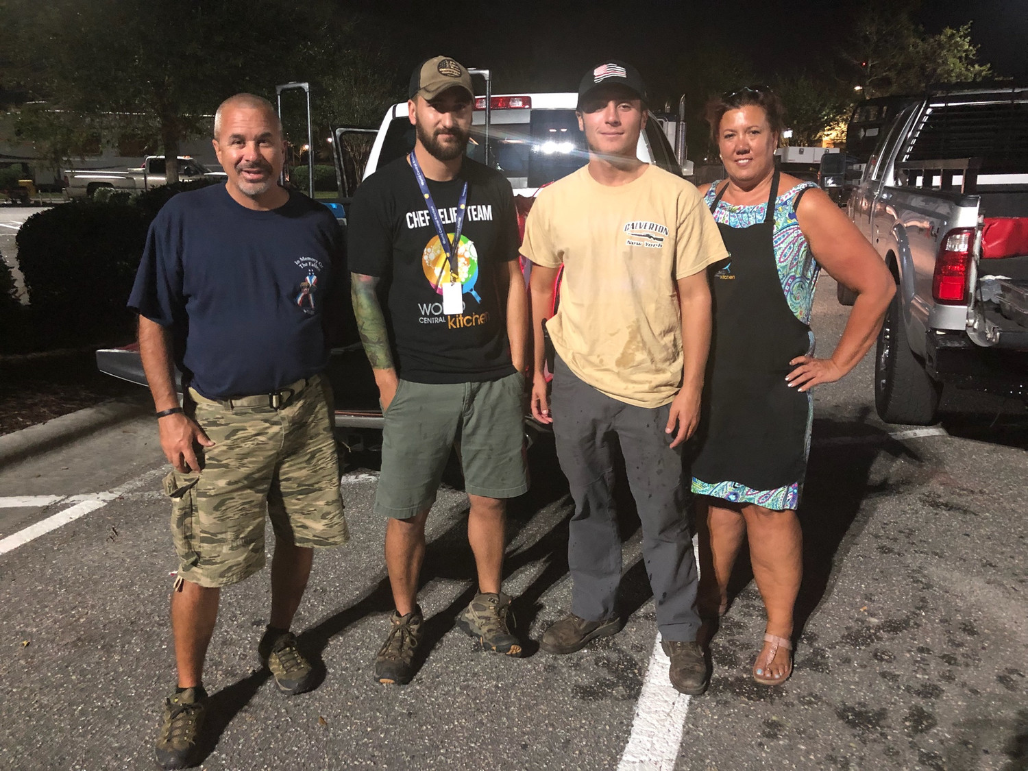 Long Beach lifeguards John Burke, far left, and Francis Nicpon, second from right, in Wilmington, N.C., with two other volunteers, Matt LeMasters and Christy Edwards of World Central Kitchen, a nonprofit that served meals to first responders and victims of Hurricane Florence.