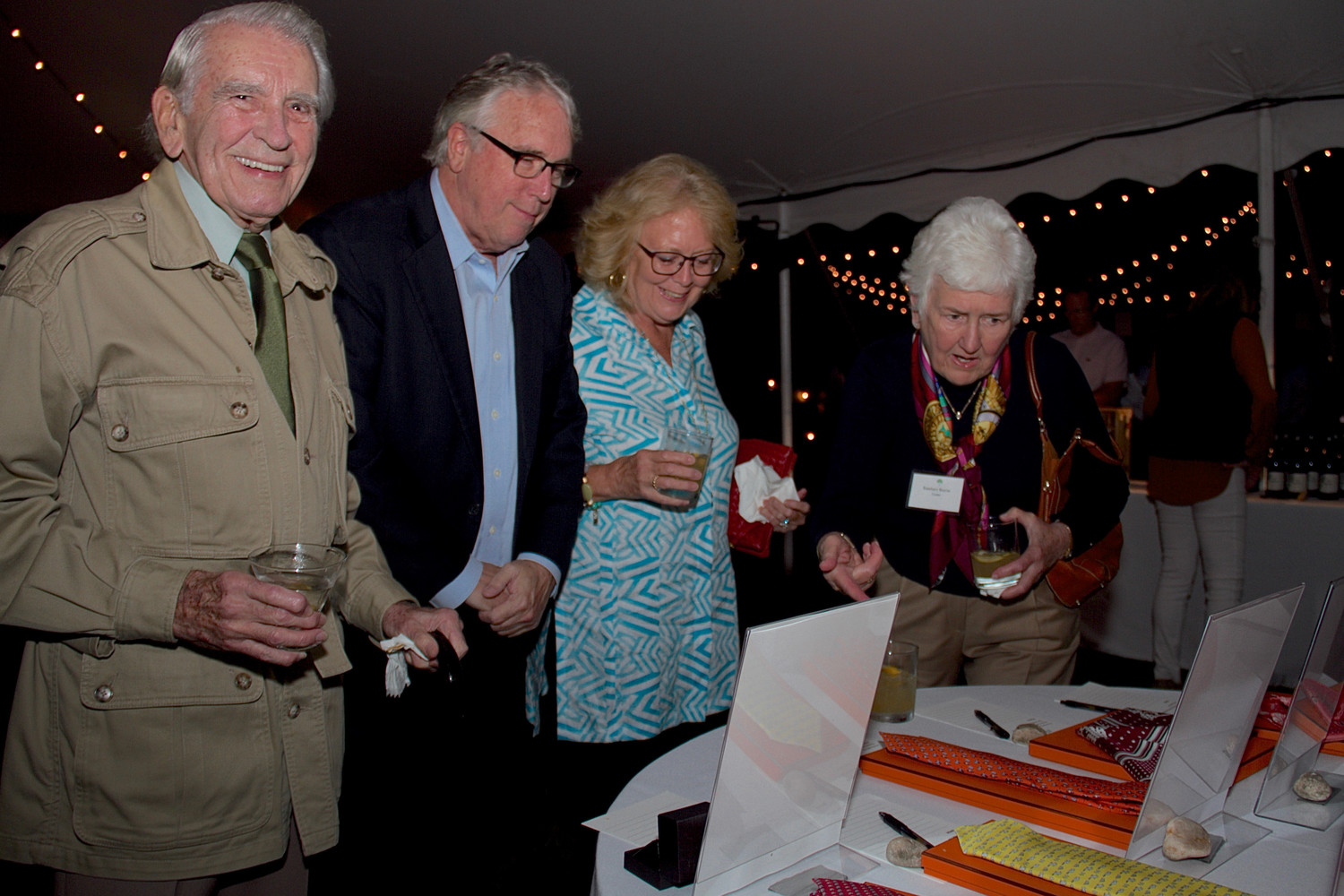 Tom McGrath, far left,  John Chase, Jean Thatcher and Rosemary Bourne looked over  the items for auction.