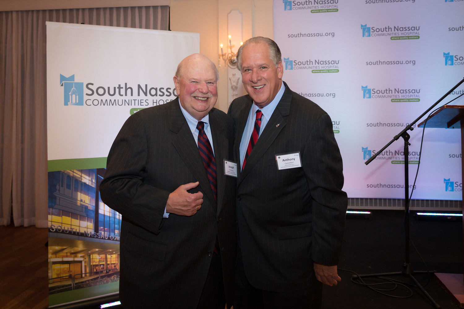 Joe Fennessy, president of the SNCH hospital Board of Directors,. stands with Anthony Cancellieri, vice chair.