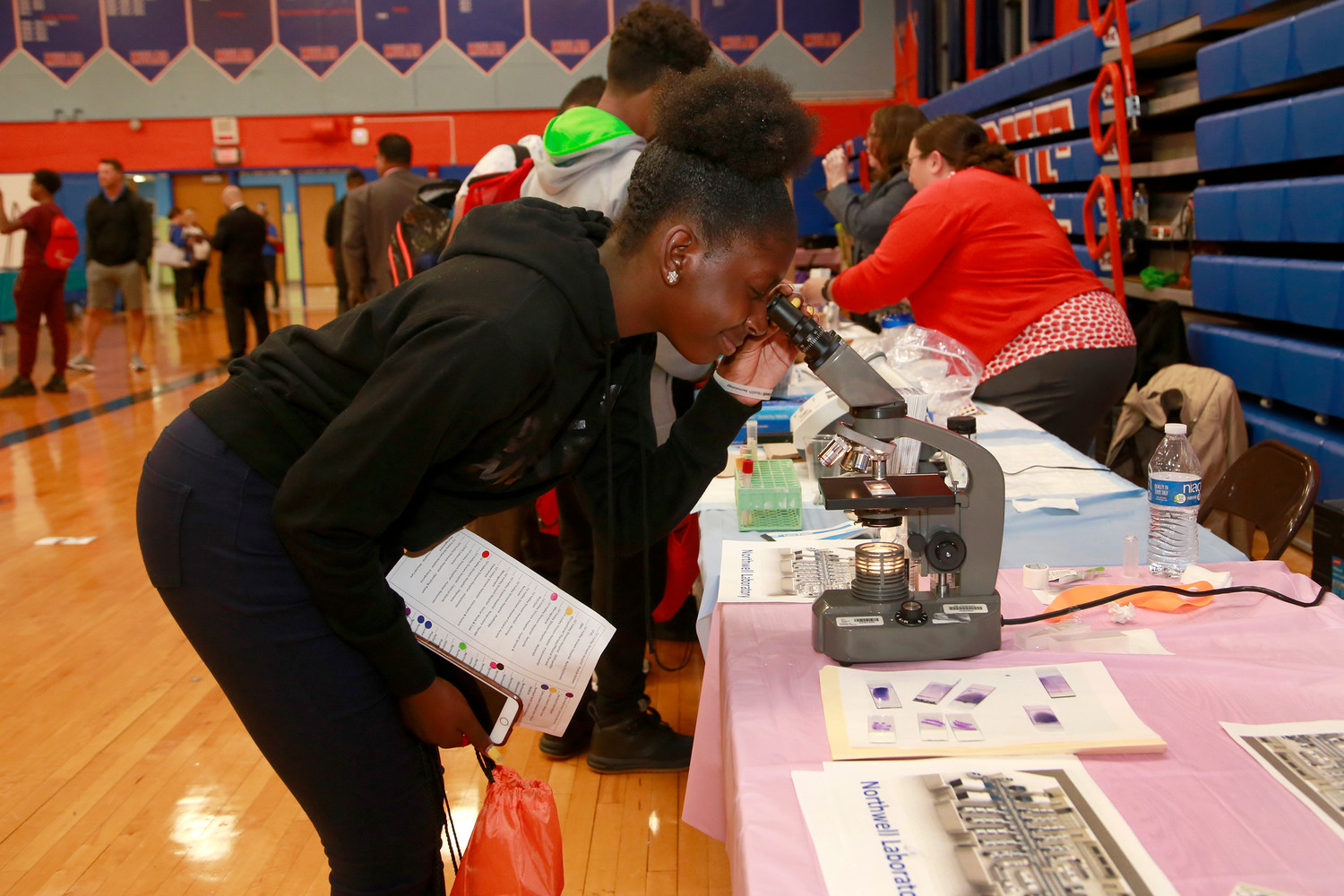 Freshman Medina Davidson examined a stomach biopsy during Medical Career Day at Malverne High School last Friday.