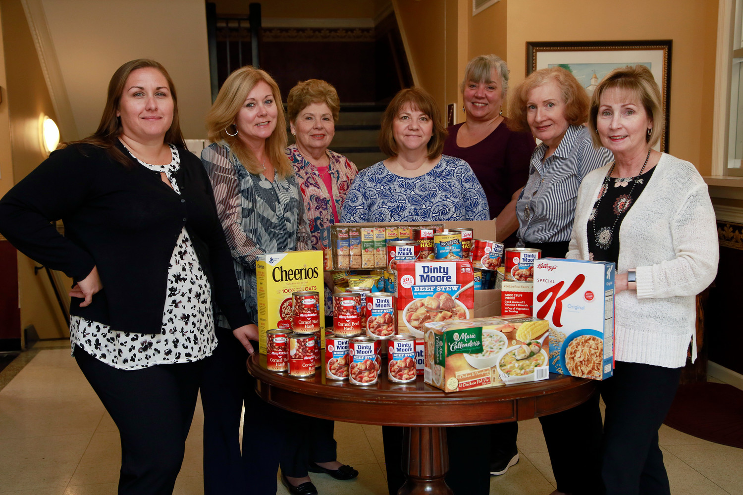 Malverne Village Hall employees Mary Kate Schnaars, far left, Lisa Lagomarsine, Rosalie Pampillonia, Jill Valle, Christine Addiego, Rose Miller and Terry Emmel helped collect food for The Bridge Church on Monday.