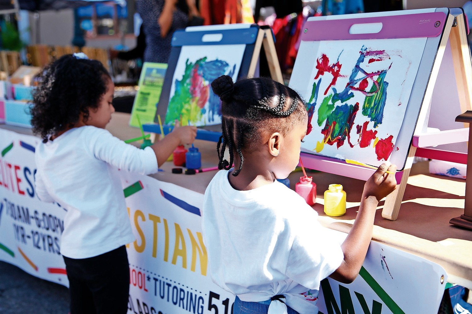 Adrianna Candelo, 4, and Siena Dezonie, 3, are students at Elite Scholars Christian Academy. They painted masterpieces at the seventh annual Community Fest on Sept. 29.