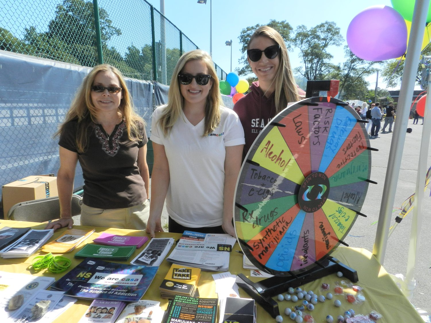 North Shore School District's social workers, Rachel McAree, left, Reisa Berga and Kaitlin Harvey, provided the community with information about substance abuse education and prevention.