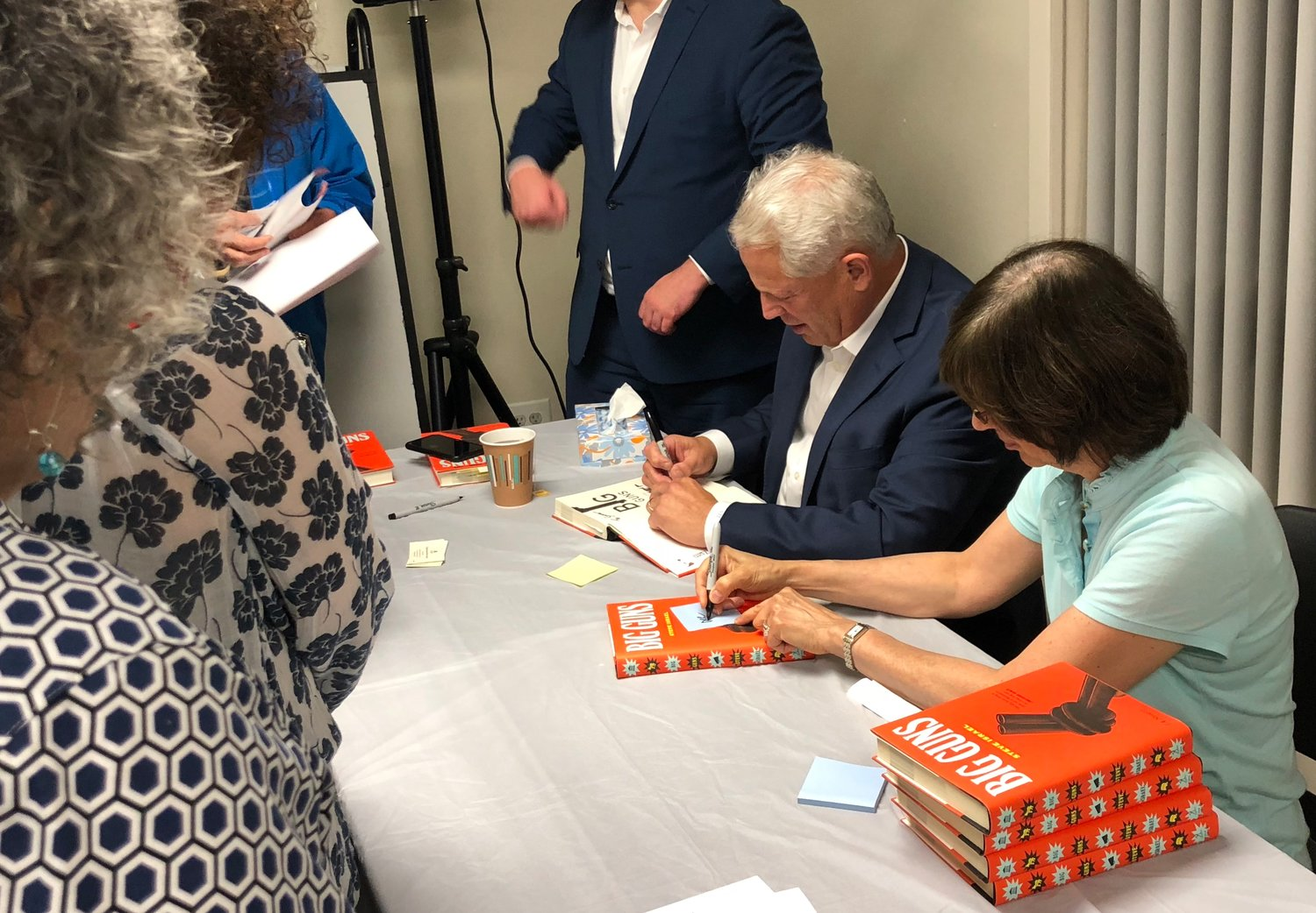 The Gold Coast Library was visited by former congressman Steve Israel, seated, who gave a lecture on his new book, answered questions from readers and signed copies.