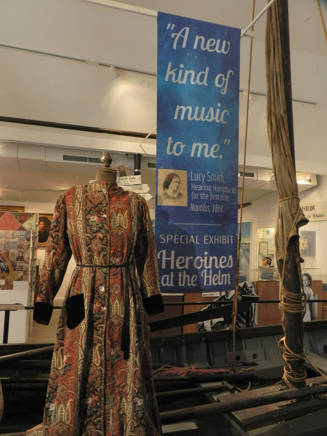 "An ornate dressing gown is on display in an unusual place — the center of a ship. The piece is part of the the Whaling Museum & Education Center of Cold Spring Harbor's latest exhibit, ""Heroines at the Helm."""