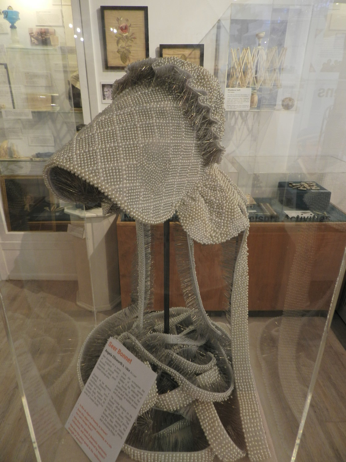 A seer bonnet on loan from a museum in Arizona demonstrates the qualities of whaling wives: pain as well as hidden power and strength.