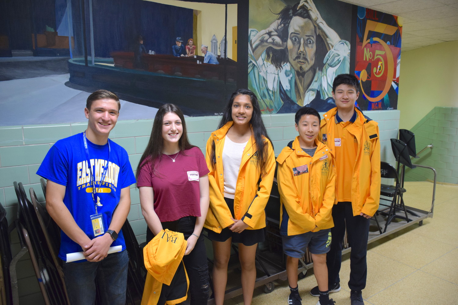 Glenn Newberger, left, a senior at East Meadow High School, led a group of Australian high school students on a tour of his school.