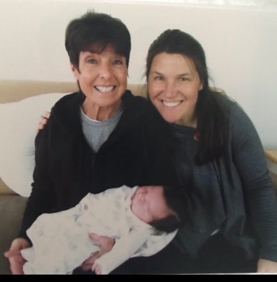 Wisey with Koegel and her newly born daughter, Grace, in April.