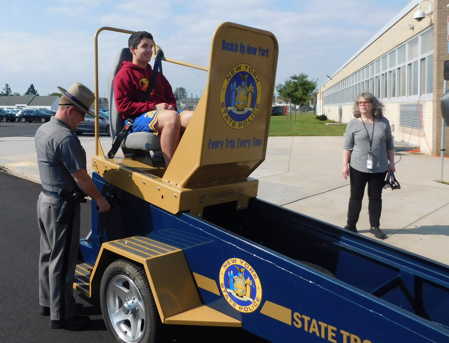 "The ""seat belt convincer"" was brought to John F. Kennedy High School. Daniel Delgado buckled in and received a five- to seven-mile-per-hour jolt, experiencing what a minor car accident feels like."