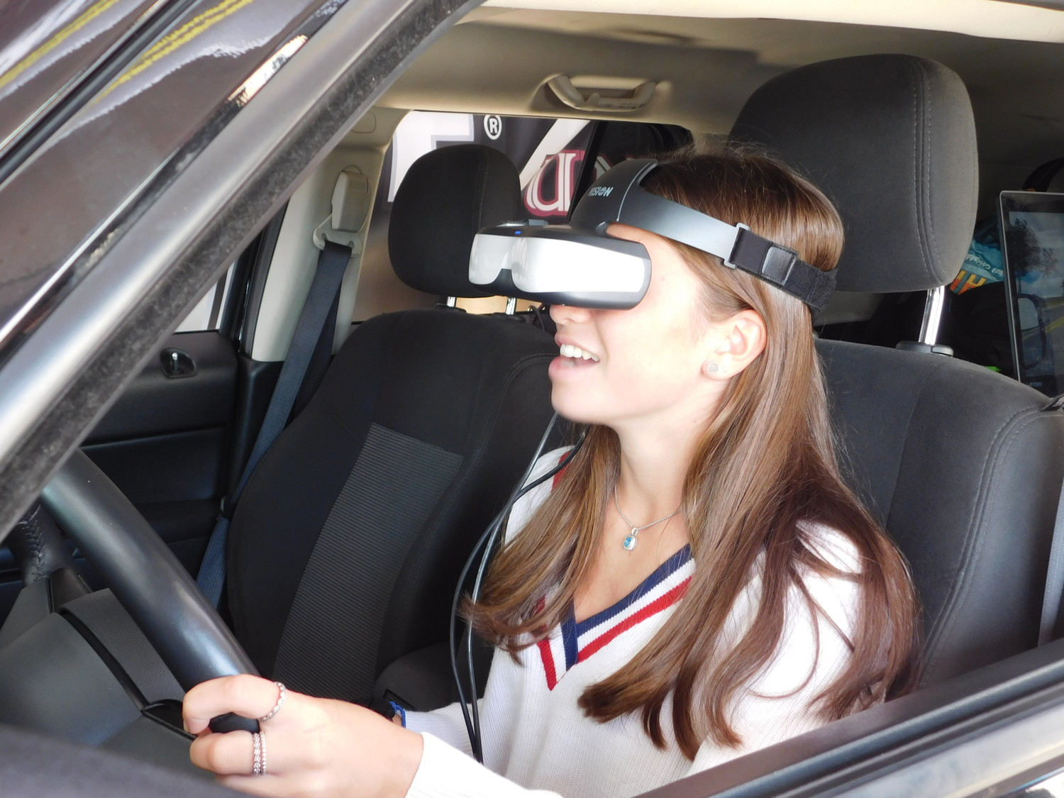 Isabella Pace donned the virtual reality headset and felt first-hand the difficulty of driving while texting.