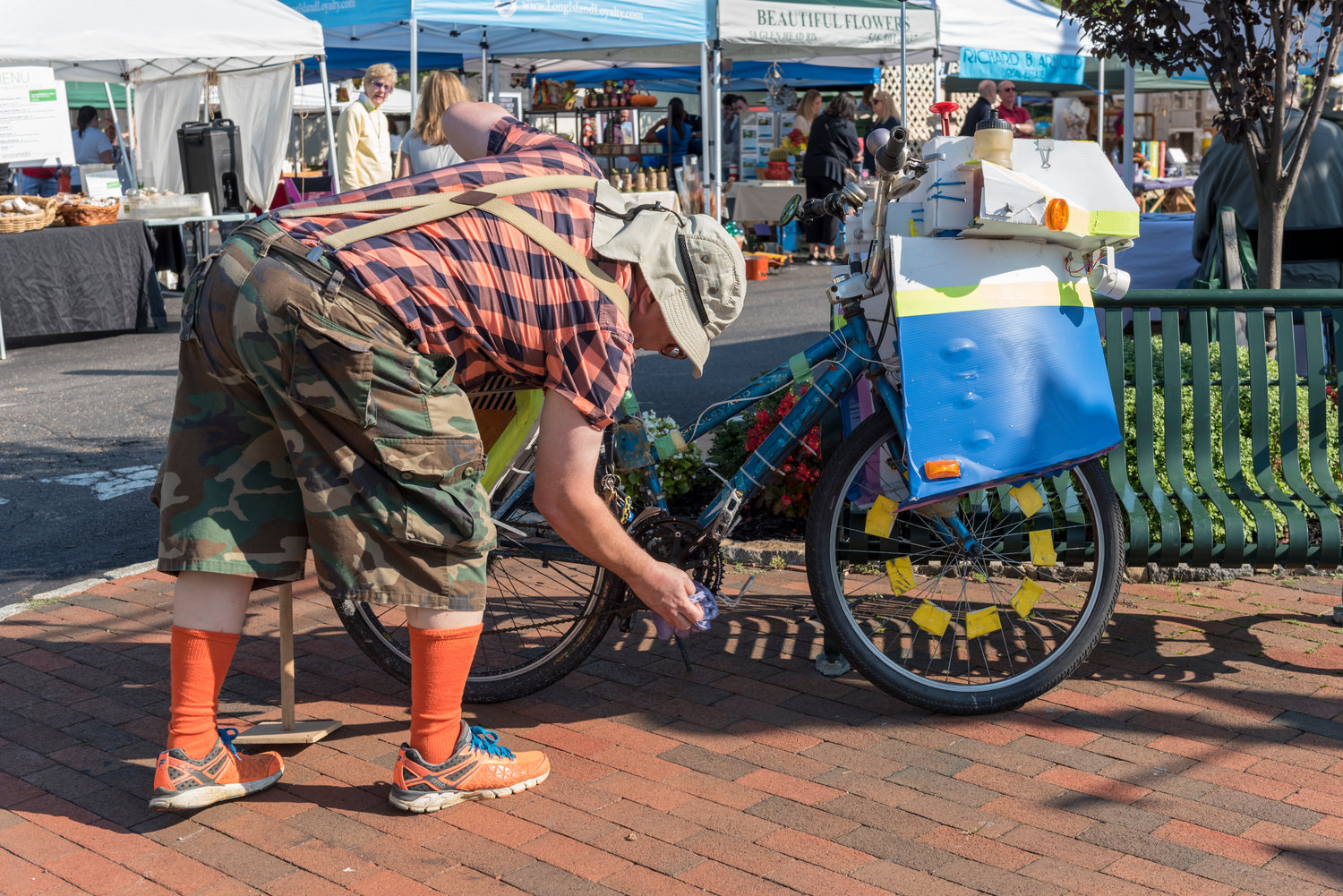 James Donohue adjusted the pedal on his bike after riding over to Fall Fest for the day.