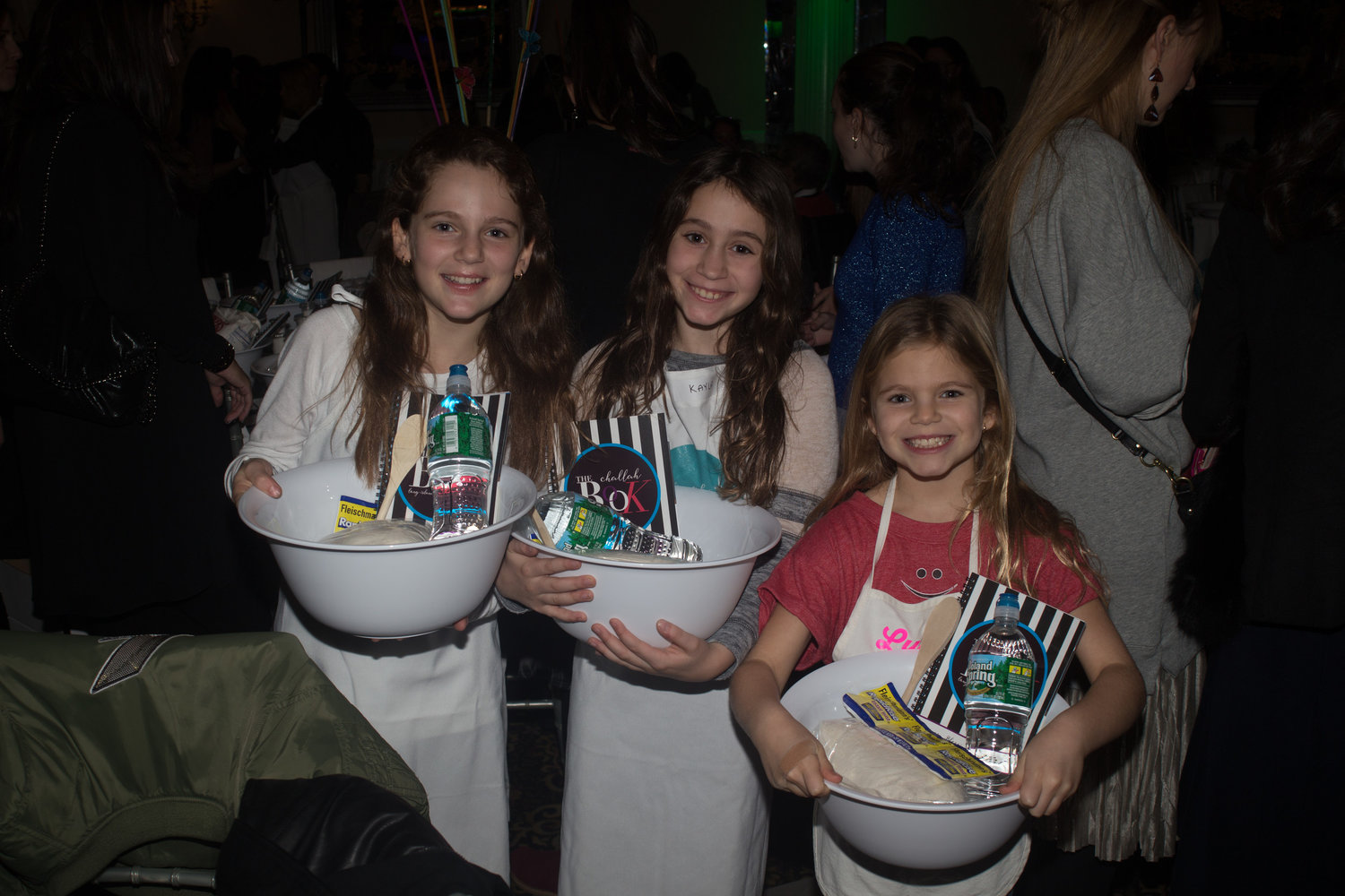 Girls and women will come from across the metropolitan area to take part in the Great Challah Bake at the Sands in Atlantic Beach on Oct. 24. Above, Kayla, with sisters Julia, left, and Lucy attended the 2016 event.