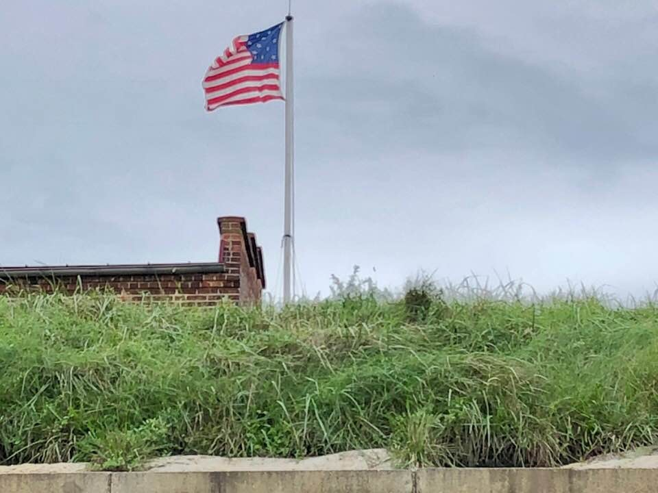 The Star-Spangled Banner, the flag, flying high above Fort McHenry.
