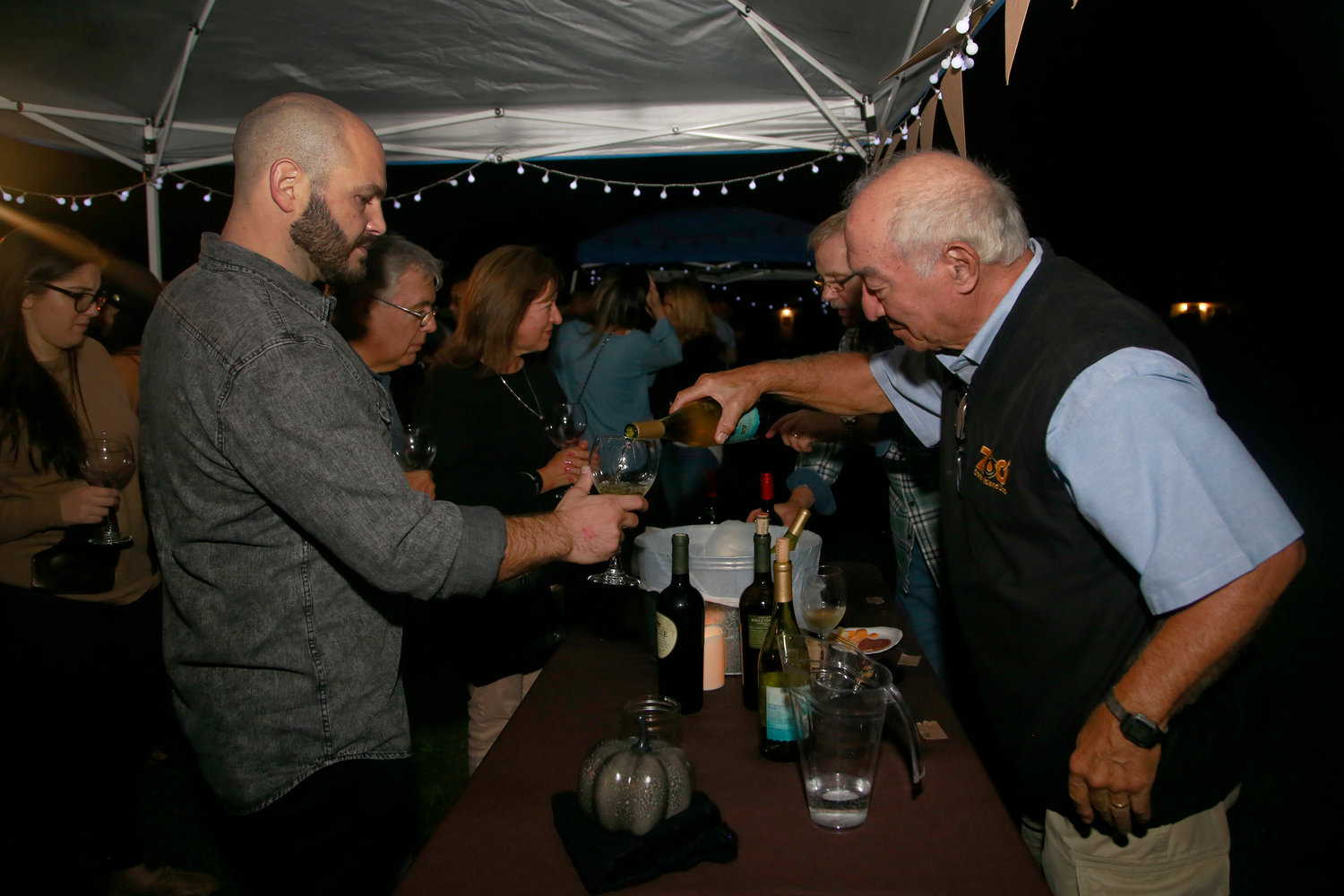 Tony Marino, left, poured Matt Inglese some California Chardonnay.