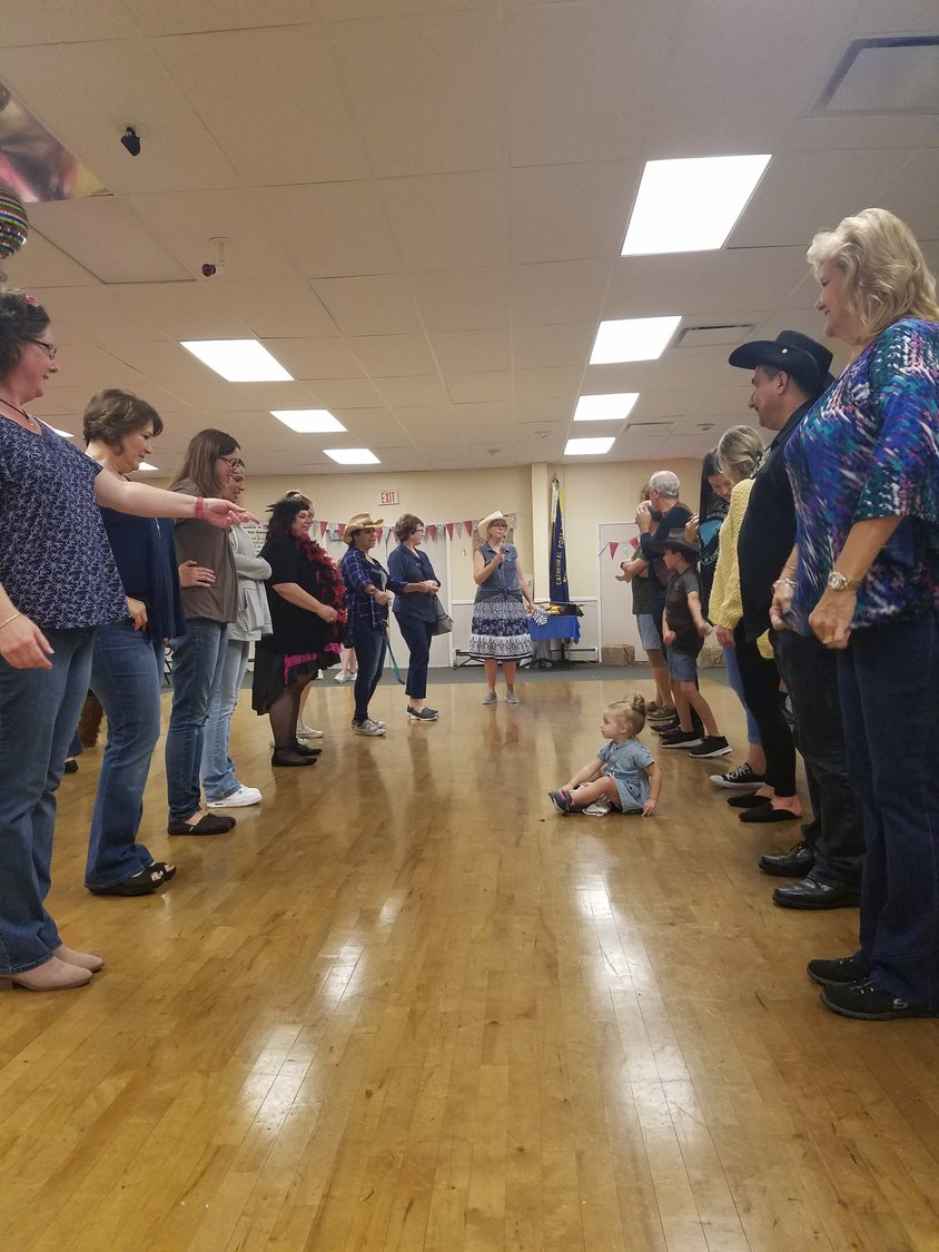 People of all ages took part in line dancing during Chicken Bingo with the W.H. Lions Club on Sept. 14.