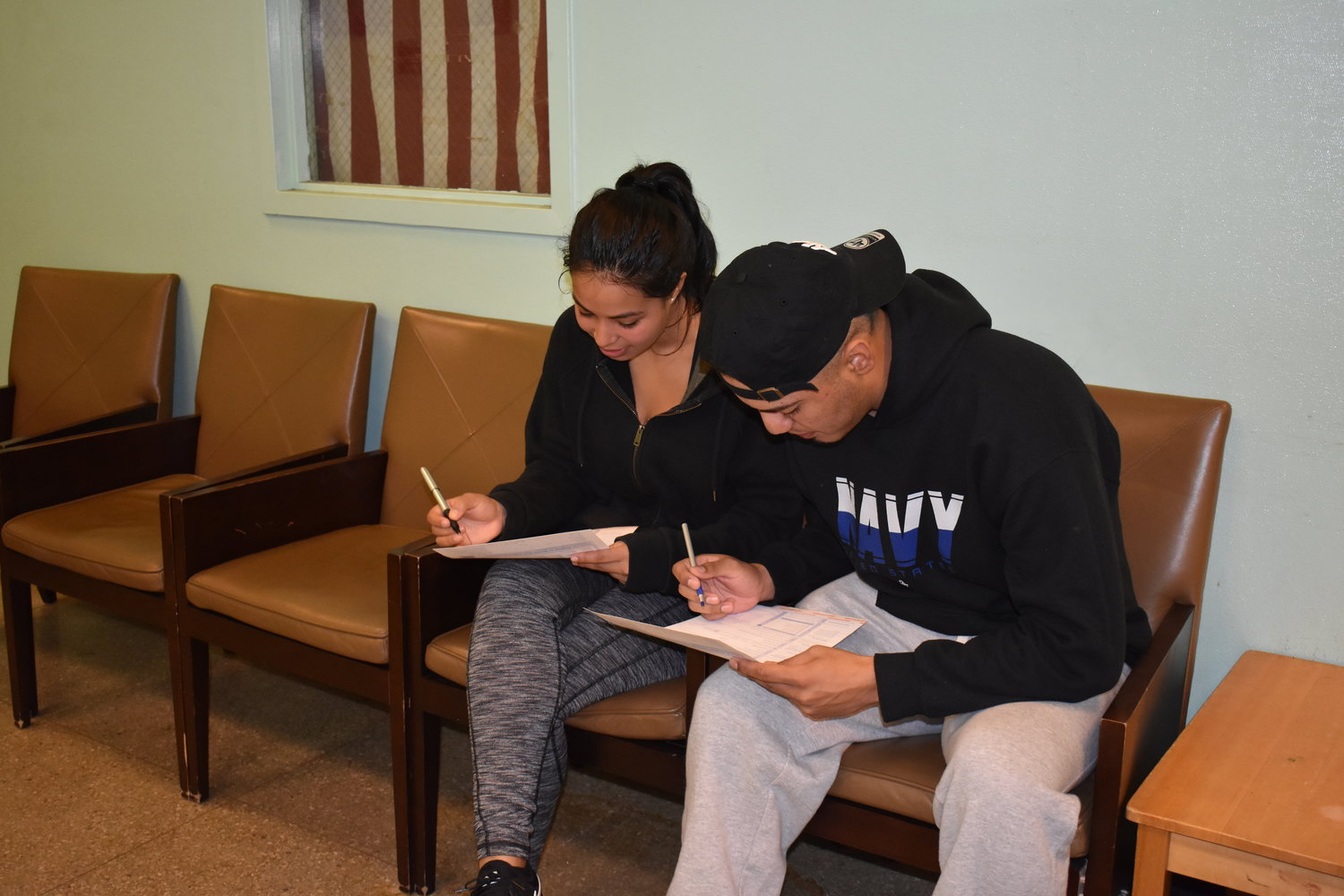 Danielle Portillo and Danny Amaya filled out the voter registration papers at the Five Towns Community Center on Oct. 8.