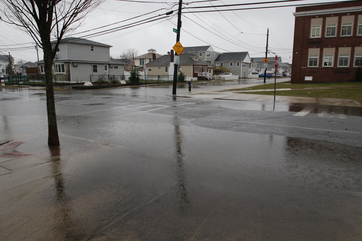 In extreme cases, a high tide can cause water to reach the doorway of the Francis Hegarty Elementary School. Issues with flooding throughout Island Park will be handled by a Federal Emergency Management Agency-funded flood mitigation project, which will soon enter its second of three phases.